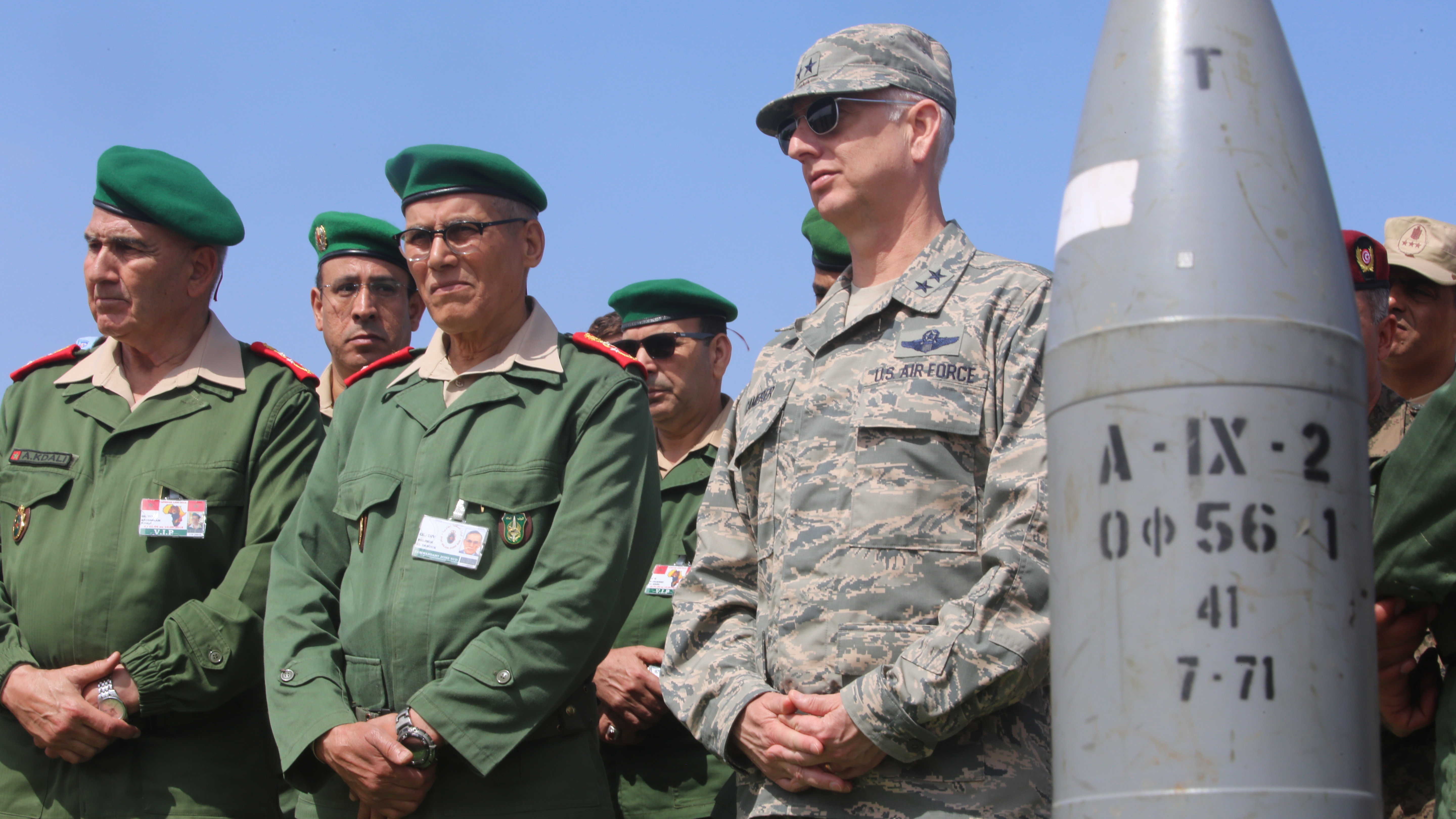 Air Force Maj.Gen. Mark Camerer, director of logistics for U.S. Africa Command, and other distinguished guests of Exercise African Lion 2018 gather during a distinguished visitor tour in Tifnit, Morocco, April 26, 2018. Marines and members of the Moroccan Royal Armed Forces demonstrated tactics, techniques, and procedures from the past two weeks of field training exercises to the distinguished visitors. Exercise African Lion 2018 is a continuation of the U.S. and Morocco's long-standing relationship focused on security cooperation. (U.S. Marine Corps photo by Sgt. Averi Coppa/Released)