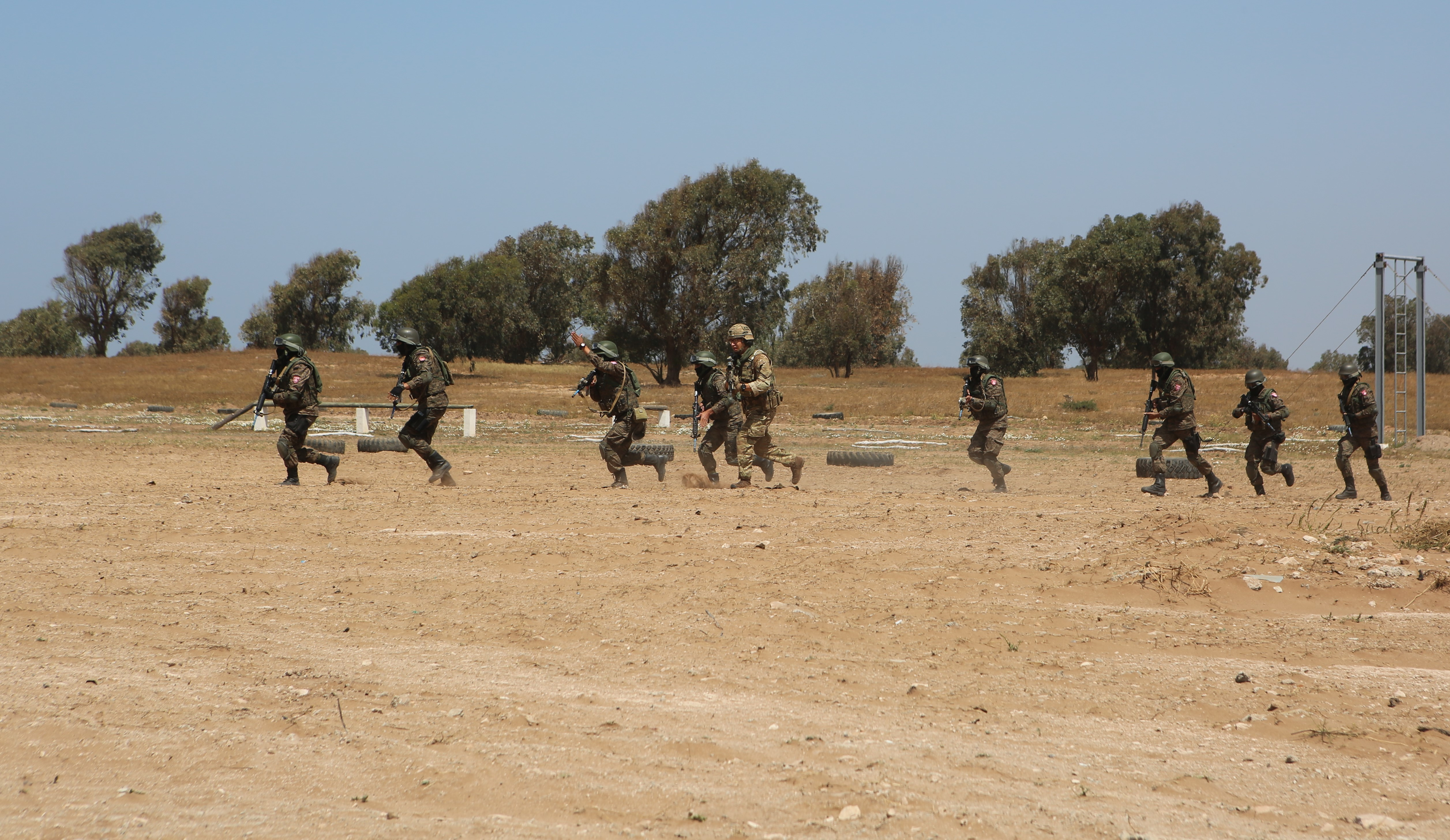 U.S. Marines and Tunisian soldiers participating in Exercise African Lion 2018 demonstrate skills learned during their field training exercise for a distinguished visitor tour delegation in Tifnit, Morocco, April 26, 2018. Exercise African Lion is a continuation of the U.S. and Morocco's long-standing relationship focused on security cooperation. (U.S. Marine Corps photo by Sgt. Averi Coppa/Released)