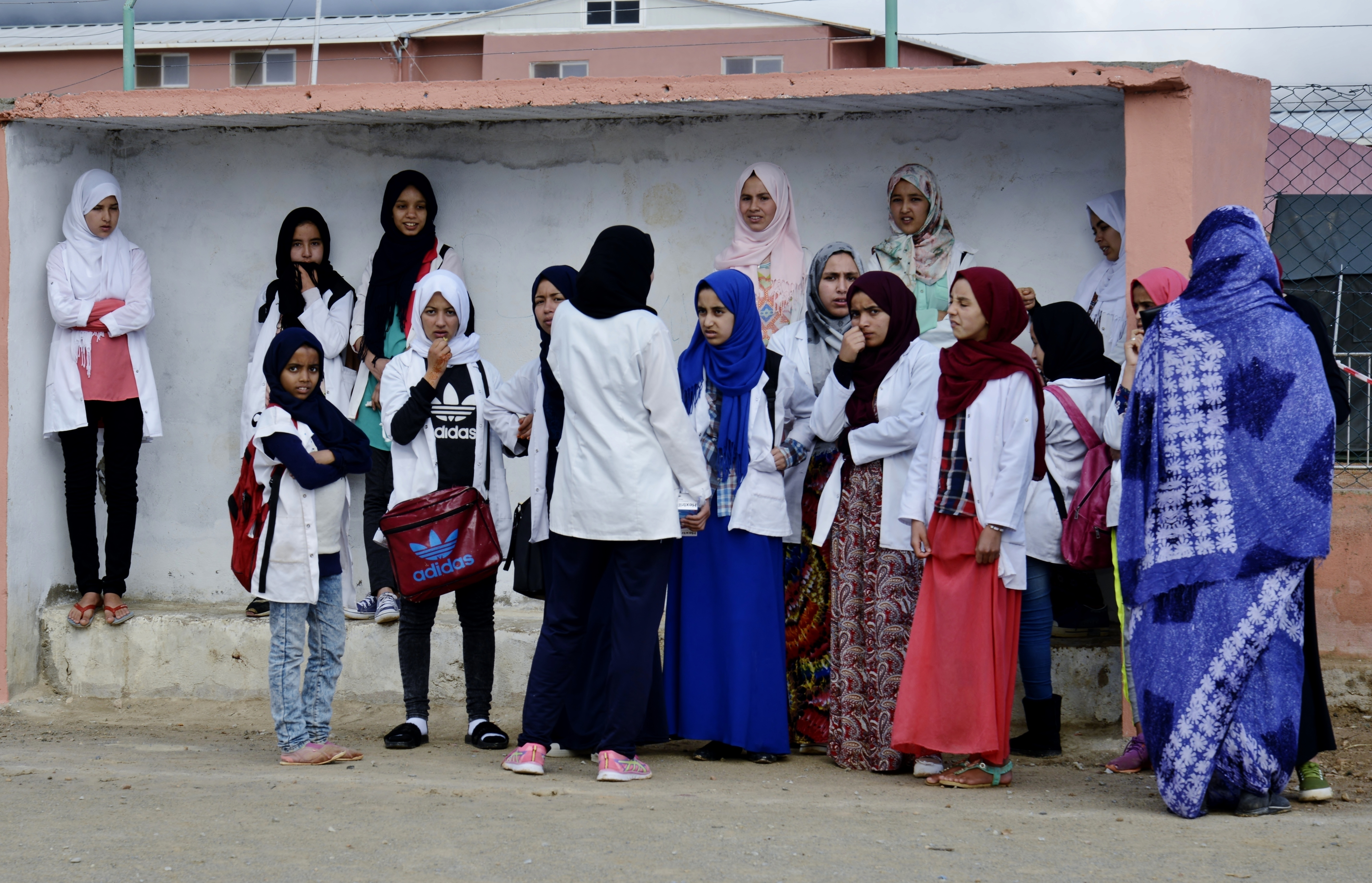 Moroccan women and young girls wait in the shade for dental services during the Humanitarian Civic Assistance component of Exercise African Lion 2018 in Bounaamane, Morocco, April 24, 2018.  Exercise African Lion 2018 is a Chairman of the Joint Chiefs of Staff-sponsored, U.S. African Command-scheduled, U.S. Marine Corps Forces Europe and Africa-led, joint and combined exercise conducted in the Kingdom of Morocco. African Lion offers an opportunity to improve interoperability and cooperation while demonstrating the strong military bond that exists between the participating nations. (U.S. Army National Guard photo by Maj. Samantha Madsen)