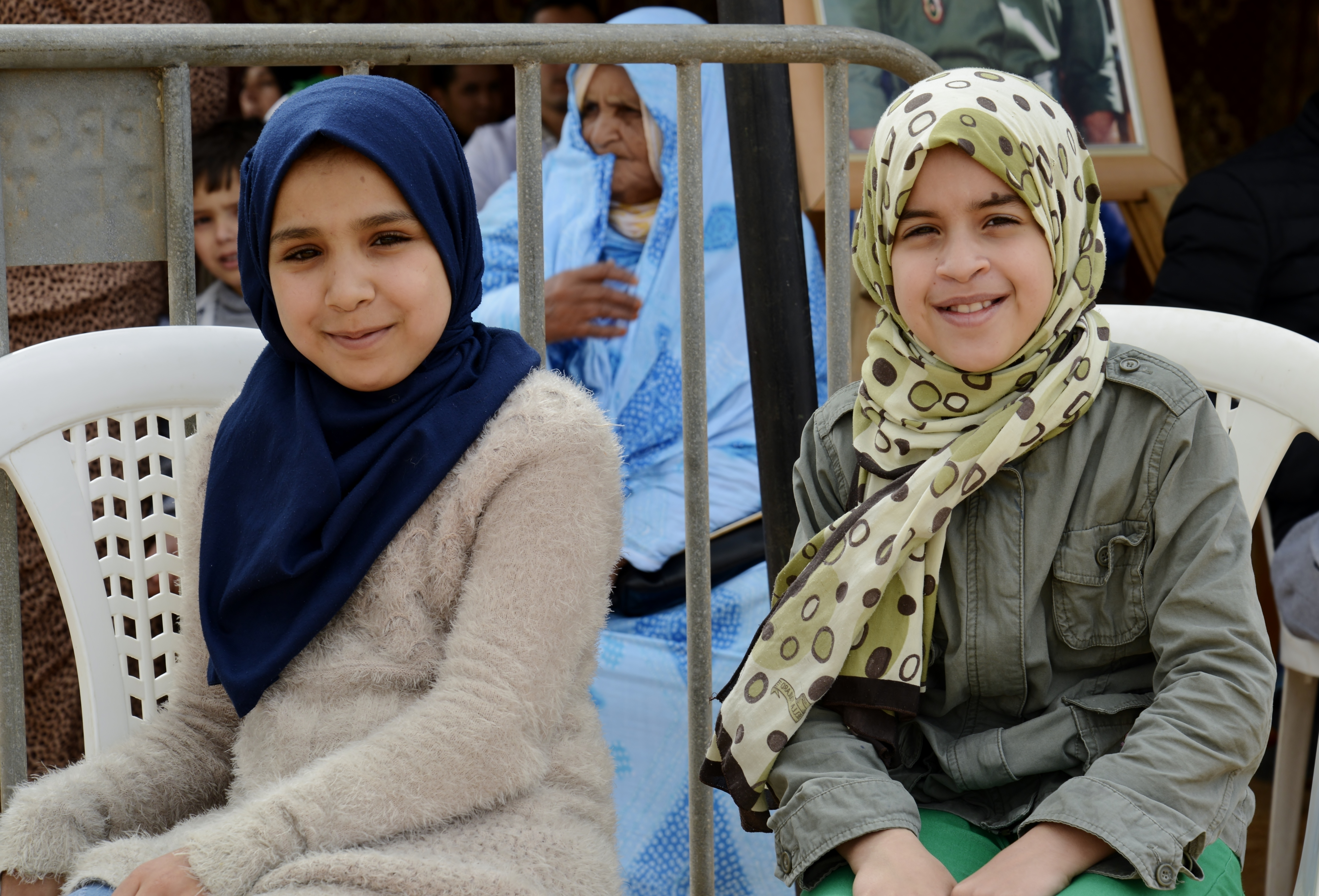Two girls waiting for dental services during the Humanitarian Civic Assistance component of Exercise African Lion 2018 in Bounaamane, Morocco, April 24, 2018.  Exercise African Lion 2018 is a Chairman of the Joint Chiefs of Staff-sponsored, U.S. African Command-scheduled, U.S. Marine Corps Forces Europe and Africa-led, joint and combined exercise conducted in the Kingdom of Morocco. African Lion offers an opportunity to improve interoperability and cooperation while demonstrating the strong military bond that exists between the participating nations. (U.S. Army National Guard photo by Maj. Samantha Madsen)