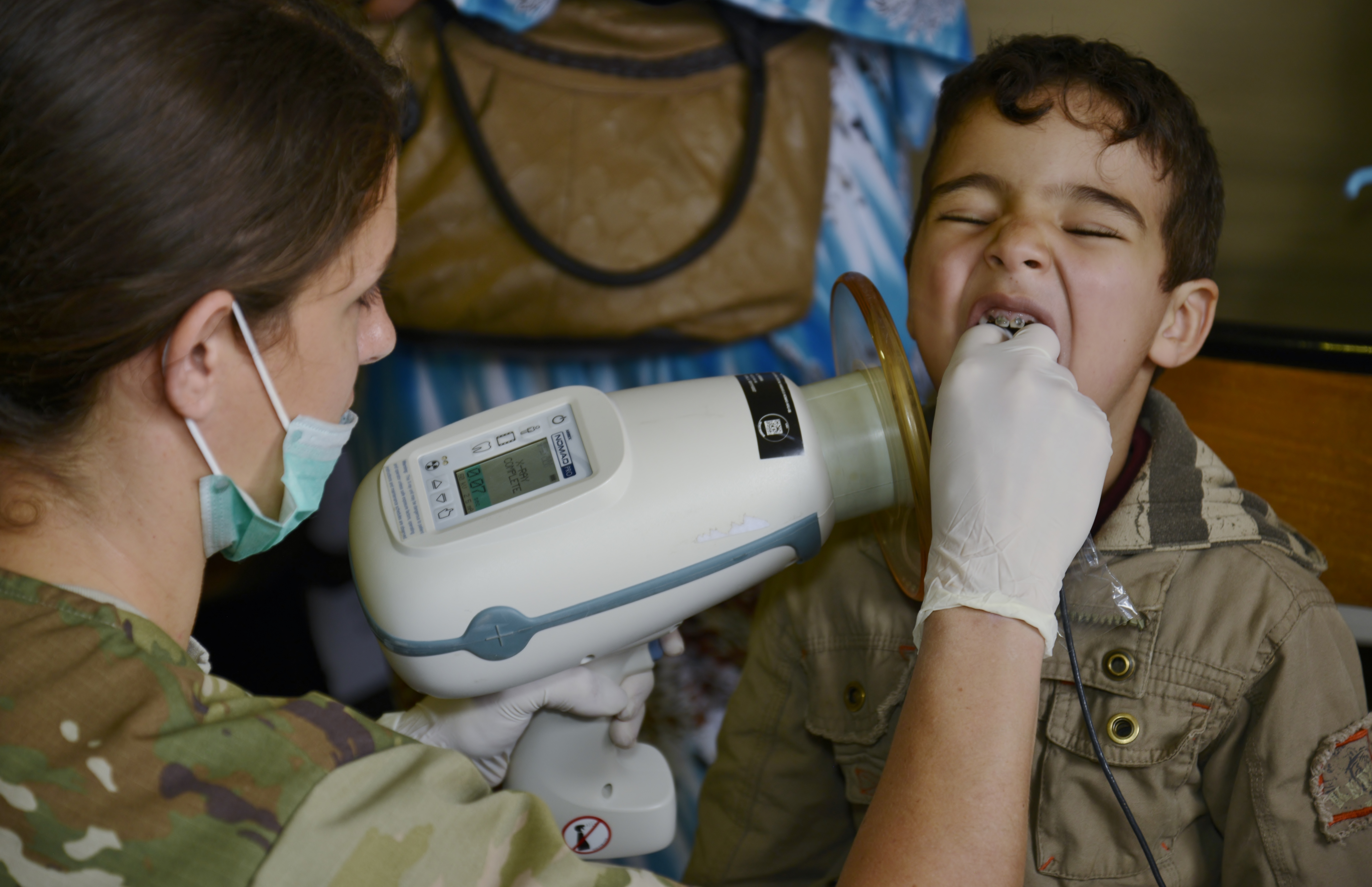Sergeant Samantha Miller, a dental technician and member of the Utah Army National Guard, takes a dental x-ray on a boy during the Humanitarian Civic Assistance component of Exercise African Lion 2018 in Bounaamane, Morocco, April 24, 2018.  Exercise African Lion 2018 is a Chairman of the Joint Chiefs of Staff-sponsored, U.S. African Command-scheduled, U.S. Marine Corps Forces Europe and Africa-led, joint and combined exercise conducted in the Kingdom of Morocco. African Lion offers an opportunity to improve interoperability and cooperation while demonstrating the strong military bond that exists between the participating nations. (U.S. Army National Guard photo by Maj. Samantha Madsen)