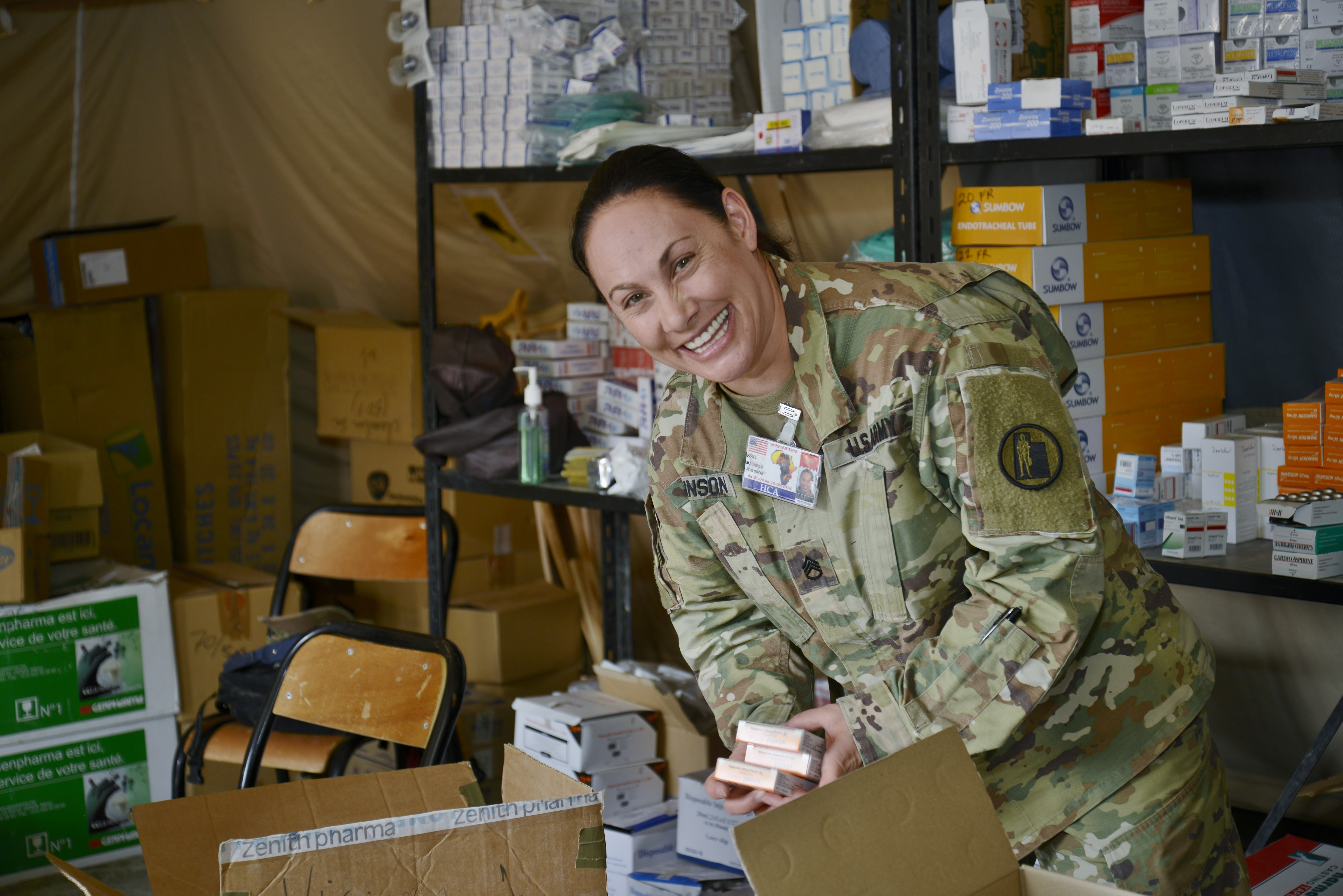 Staff Sergeant Michele Johnson, a patient administration technician with Utah Army National Guard, organizes the pharmacy during the Humanitarian Civic Assistance component of Exercise African Lion 2018 in Bounaamane, Morocco, April 25, 2018.  Exercise African Lion 2018 is a Chairman of the Joint Chiefs of Staff-sponsored, U.S. African Command-scheduled, U.S. Marine Corps Forces Europe and Africa-led, joint and combined exercise conducted in the Kingdom of Morocco. African Lion offers an opportunity to improve interoperability and cooperation while demonstrating the strong military bond that exists between the participating nations. (U.S. Army National Guard photo by Maj. Samantha Madsen)