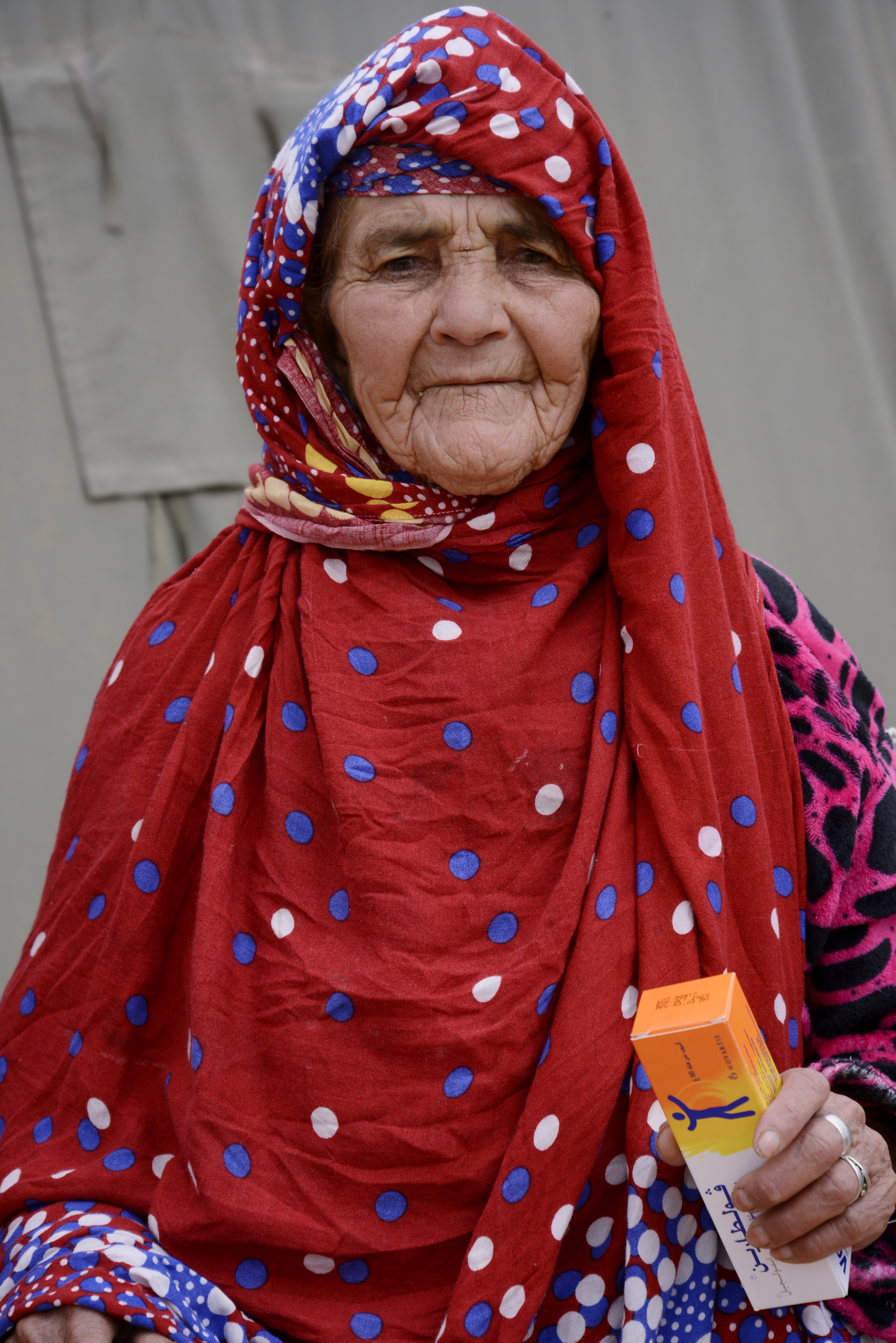 A Moroccan woman poses for a photo after receiving her medication from the pharmacy during the Humanitarian Civic Assistance component of Exercise African Lion 2018 in Bounaamane, Morocco, April 25, 2018.  Exercise African Lion 2018 is a Chairman of the Joint Chiefs of Staff-sponsored, U.S. African Command-scheduled, U.S. Marine Corps Forces Europe and Africa-led, joint and combined exercise conducted in the Kingdom of Morocco. African Lion offers an opportunity to improve interoperability and cooperation while demonstrating the strong military bond that exists between the participating nations. (U.S. Army National Guard photo by Maj. Samantha Madsen)
