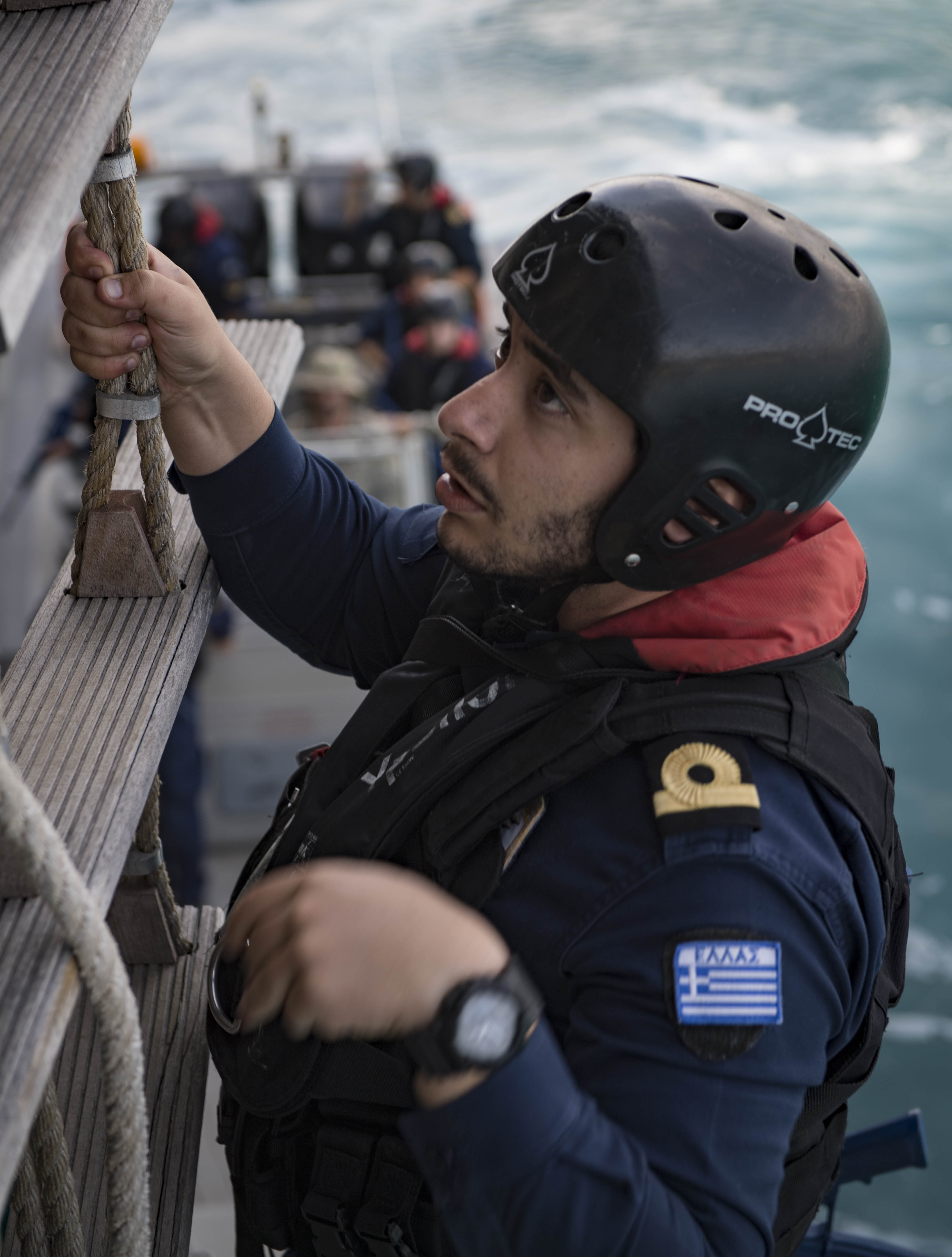 180502-N-UY653-215 SOUDA BAY, Greece (May 2, 2018) A Hellenic Navy sailor boards vessel during visit, board, search and seizure training during exercise Phoenix Express 2018, May 2. Phoenix Express is sponsored by U.S. Africa Command and facilitated by U.S. Naval Forces Europe-Africa/U.S. 6th Fleet, and is designed to improve regional cooperation, increase maritime domain awareness information sharing practices, and operational capabilities to enhance efforts to achieve safety and security in the Mediterranean Sea. (U.S. Navy photo by Mass Communication Specialist 2nd Class Ryan U. Kledzik/Released)