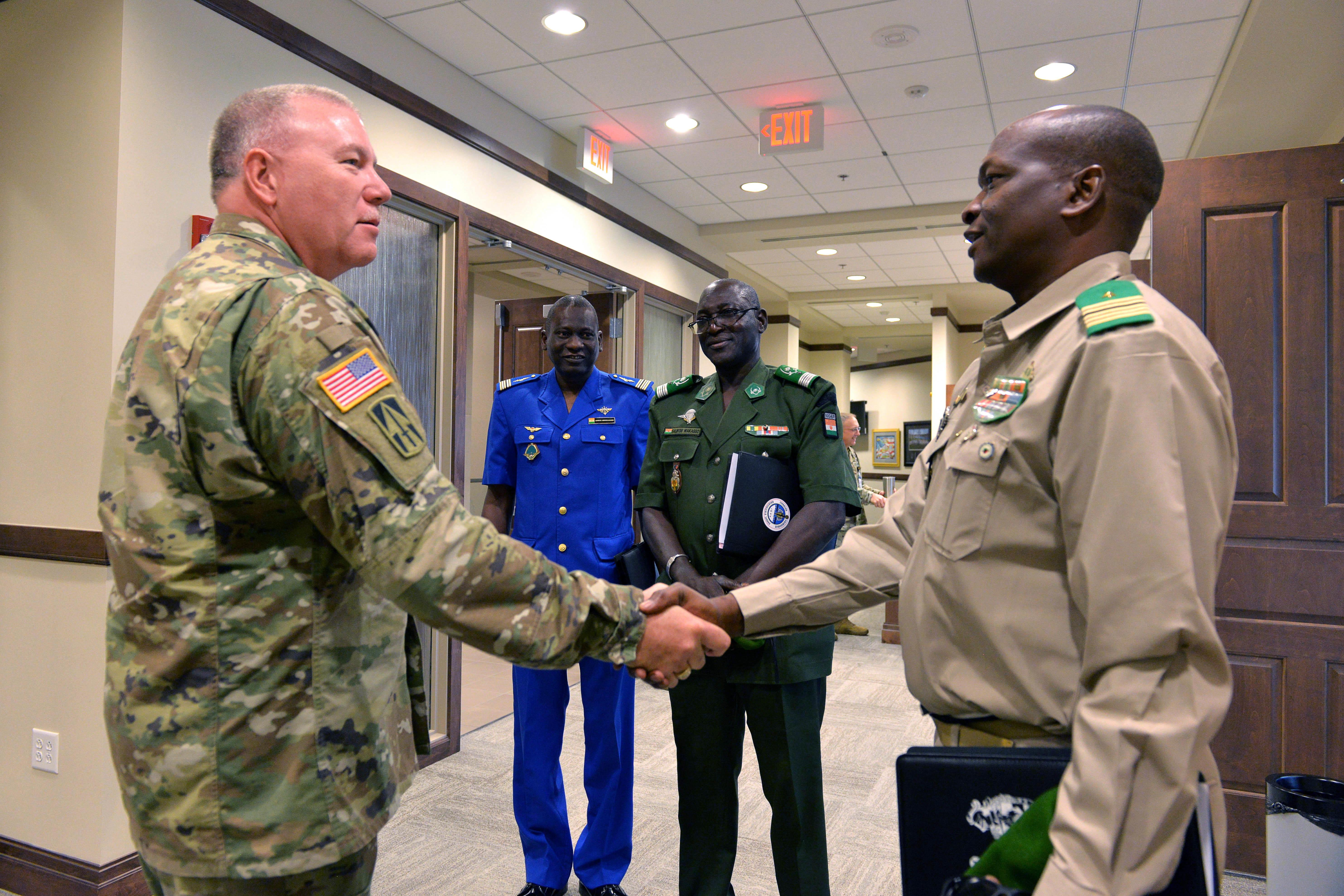 Indiana National Guard's Director of Joint Staff Brig. Gen. Ronald A. Westfall greats Colonel-Major Soumana Kalkoye dit Fodo the Chief of Bureau of Studies for the Nigerien Ministry of Defense. (Photo by Sgt. 1st Class Lasima O. Packett/Released)