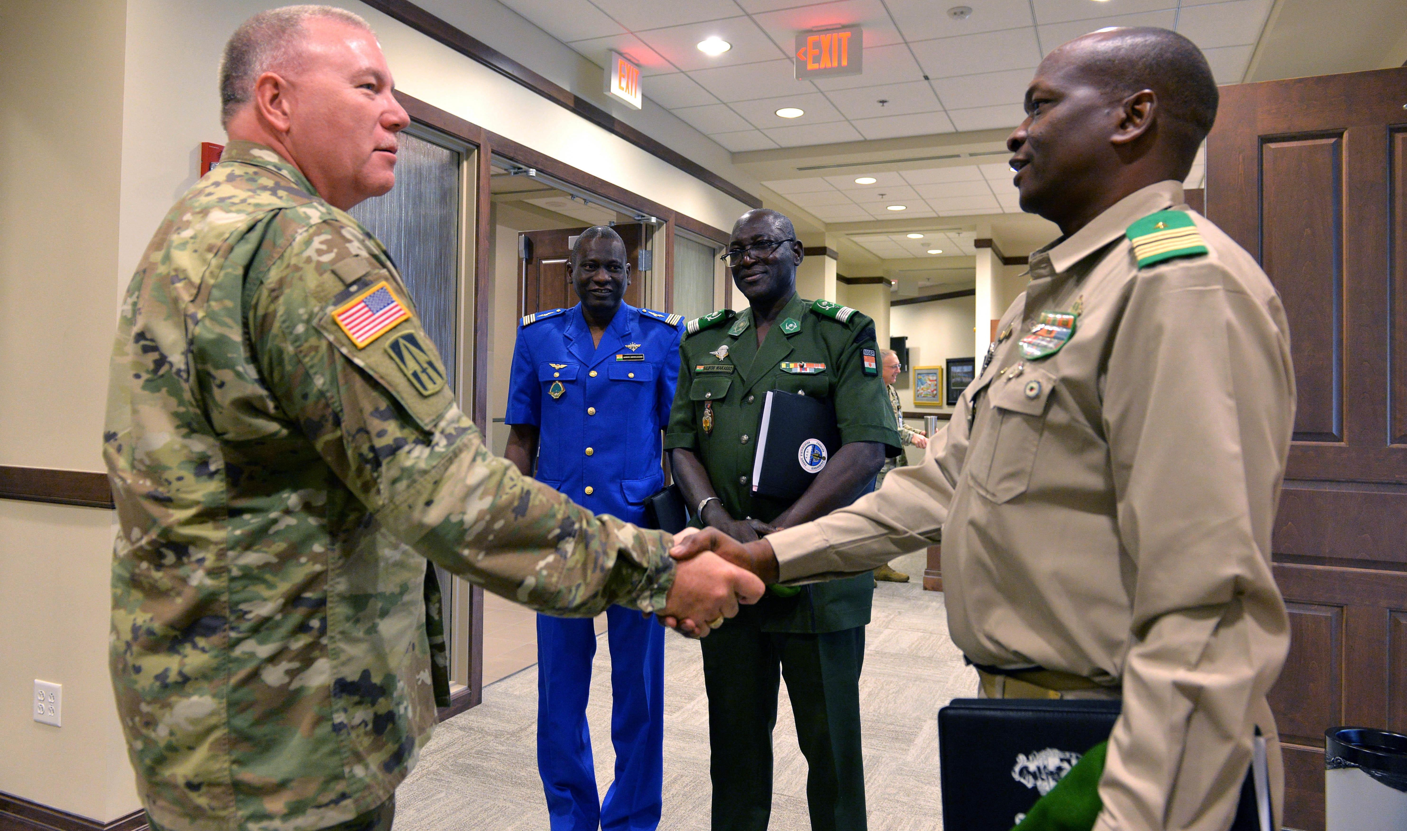 Indiana National Guard's Director of Joint Staff Brig. Gen. Ronald A. Westfall greats Colonel-Major Soumana Kalkoye dit Fodo the Chief of Bureau of Studies for the Nigerien Ministry of Defense. Photo by Sgt. 1st Class Lasima O. Packett