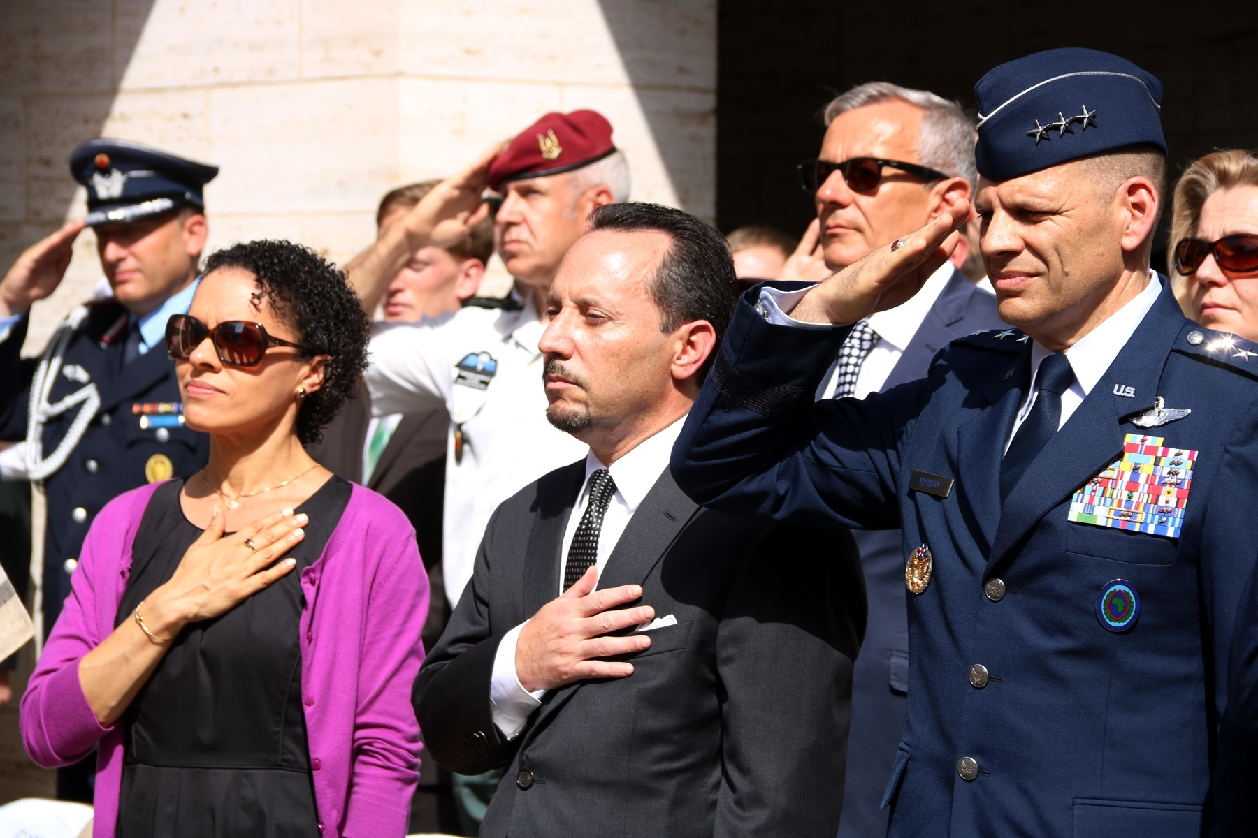 U.S. Air Force Lt. Gen. James C. Vechery, Deputy to the Commander for Military Operations, U.S. Africa Command (right), and Amb. Daniel Rubinstein, U.S. Ambassador to Tunisia, salute the military honor guard as it passes in formation as part of the Memorial Day ceremony in Carthage, Tunisia, May 28, 2018. (Photo by Zouhaier SFAXI, U.S. Embassy Tunis)