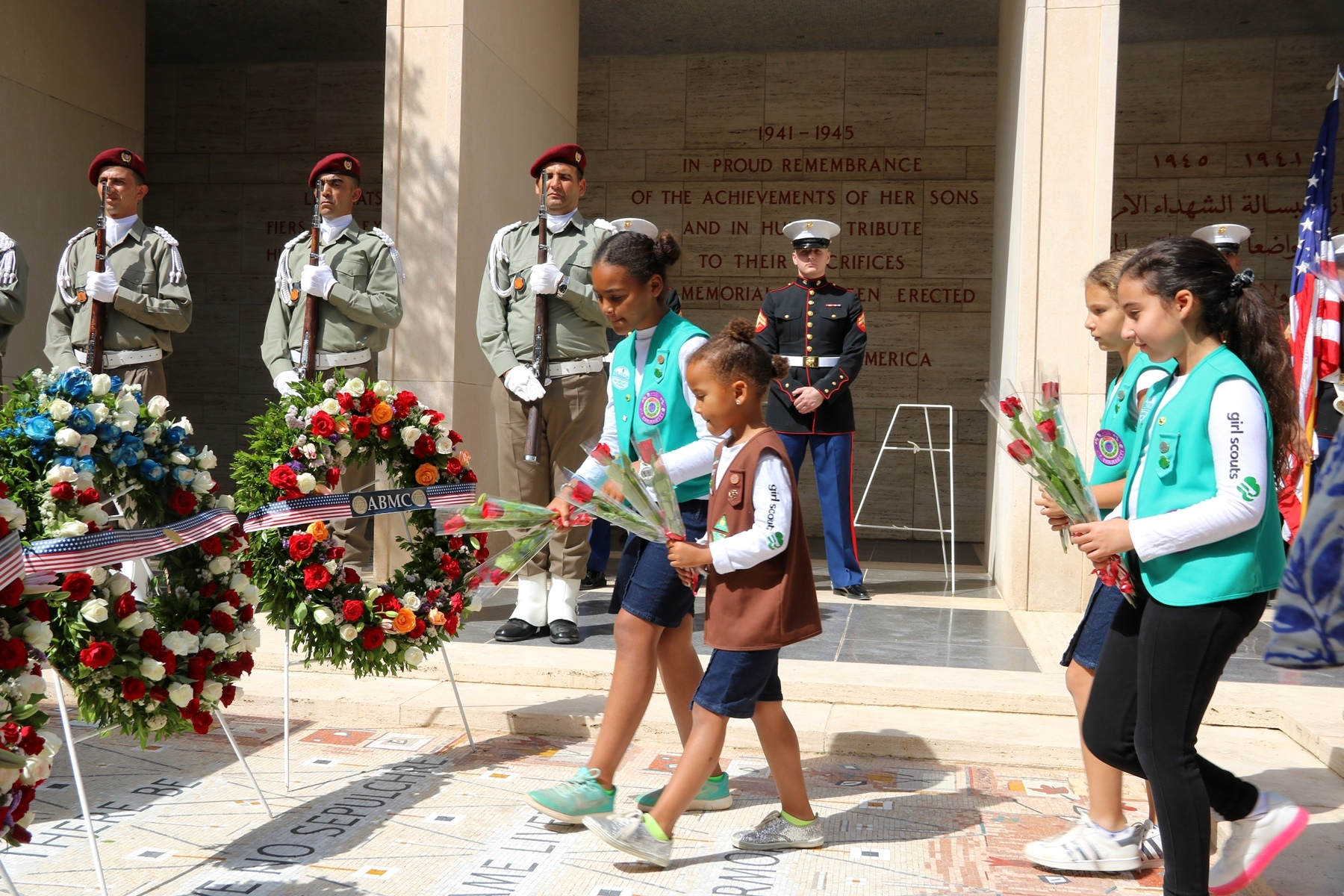 Members of a local Girl Scout troop lay flowers in honor of American servicemen as part of the Memorial Day ceremony in Carthage, Tunisia, May 28, 2018. (Photo by Zouhaier SFAXI, U.S. Embassy Tunis)