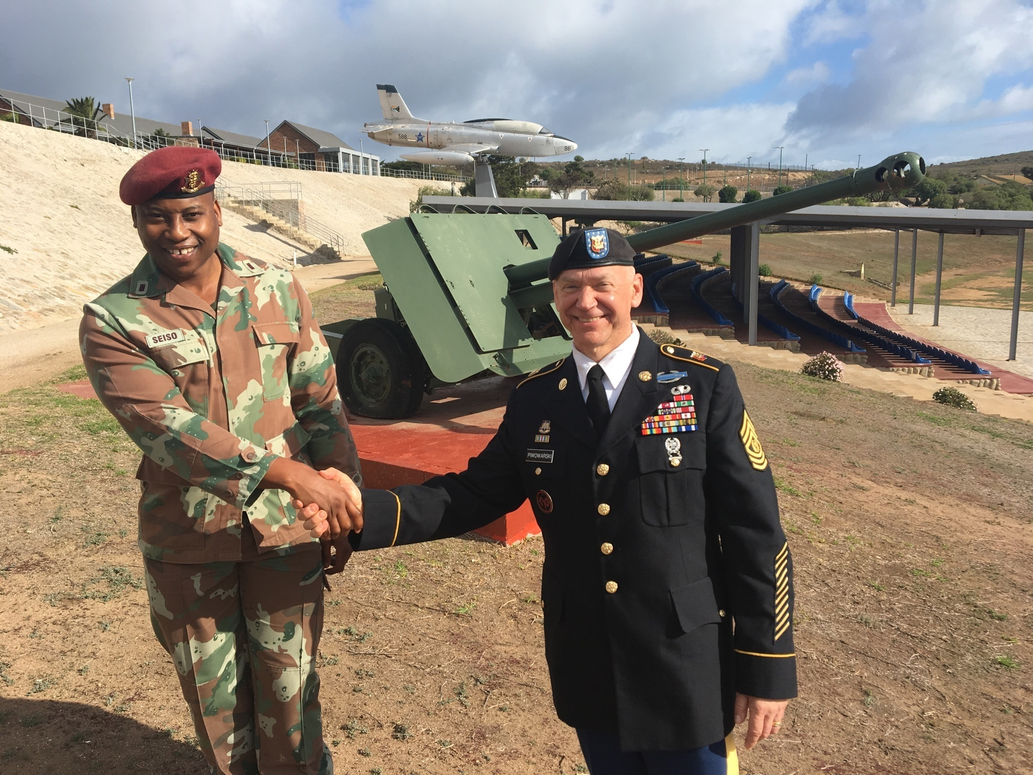 New York Army National Guard Command Sgt. Major David Piwowarski, meets with Cadet T. Seiso at the Military Academy of South Africa in Saldanha,  Western Cape Province, South Africa on May 8, 2018. German was speaking at the Academy as part of an exchange program executed as part of the New York National Guard State Partnership Program relationship with the South African National Defense Force. (U.S. Army National Guard photo by Major Al Philips.)