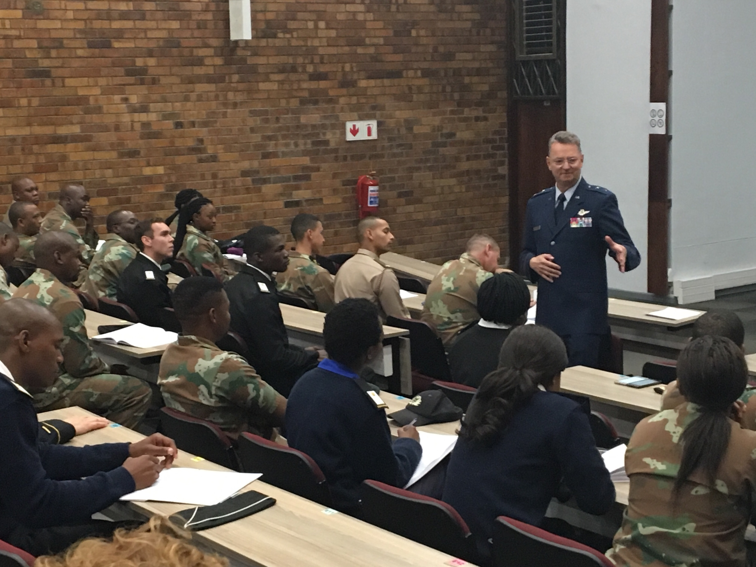 Major General Anthony German, the Adjutant General of New York, meets with cadets at the Military Academy of South Africa in Saldanha,  Western Cape Province, South Africa on May 8, 2018. German was speaking at the Academy as part of an exchange program executed as part of the New York National Guard State Partnership Program relationship with the South African National Defense Force. (U.S. Army National Guard photo by Major Al Philips.)