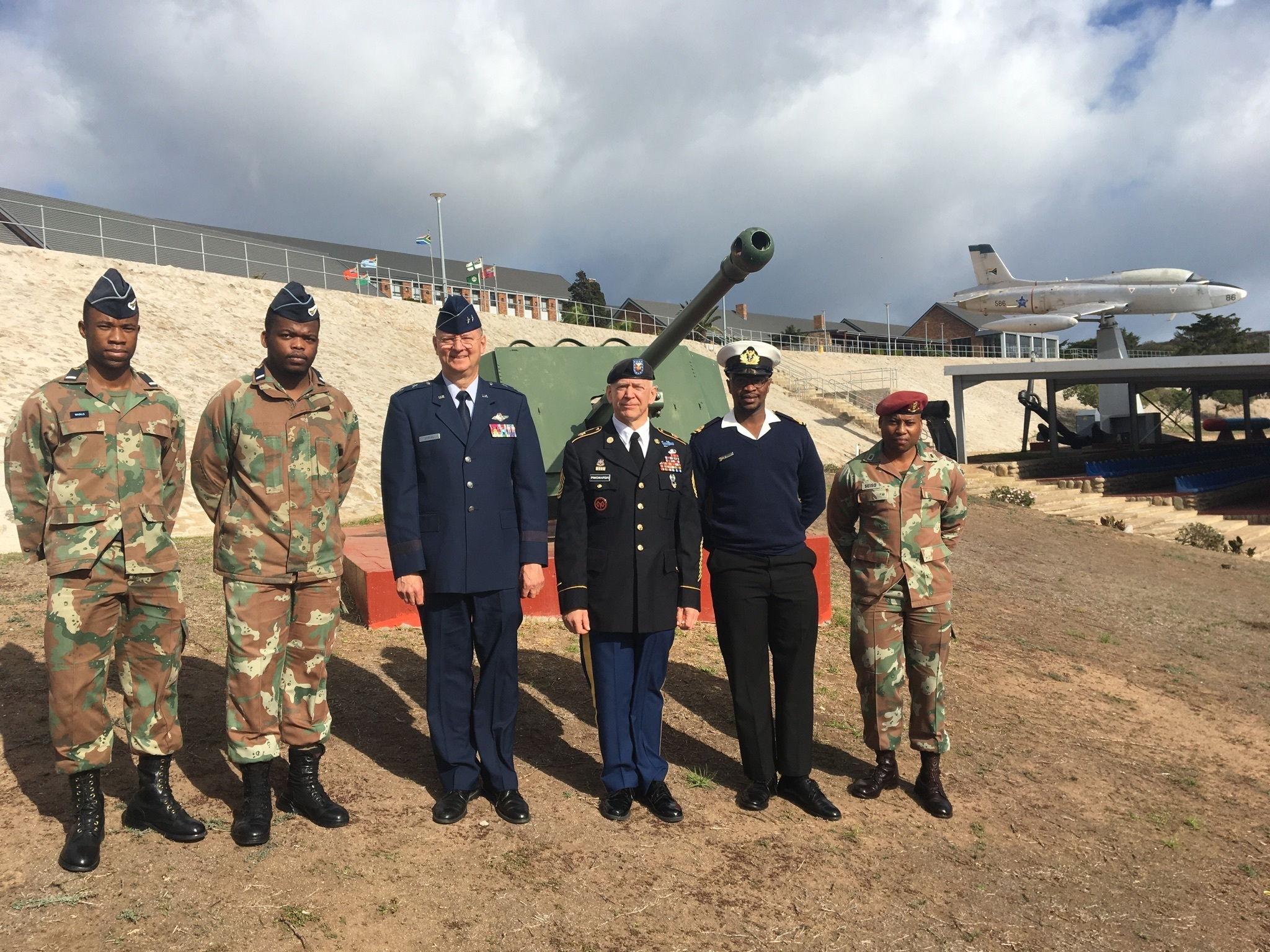 Major General Anthony German, the Adjutant General of New York, ( second from left) and New York Army National Guard Command Sgt. Major David Piwowarski ( second from right) pose with students at the Military Academy of South Africa in Saldanha,  Western Cape Province, South Africa on May 8, 2018. German was speaking at the Academy as part of an exchange program executed as part of the New York National Guard State Partnership Program relationship with the South African National Defense Force. (U.S. Army National Guard photo by Major Al Philips.)