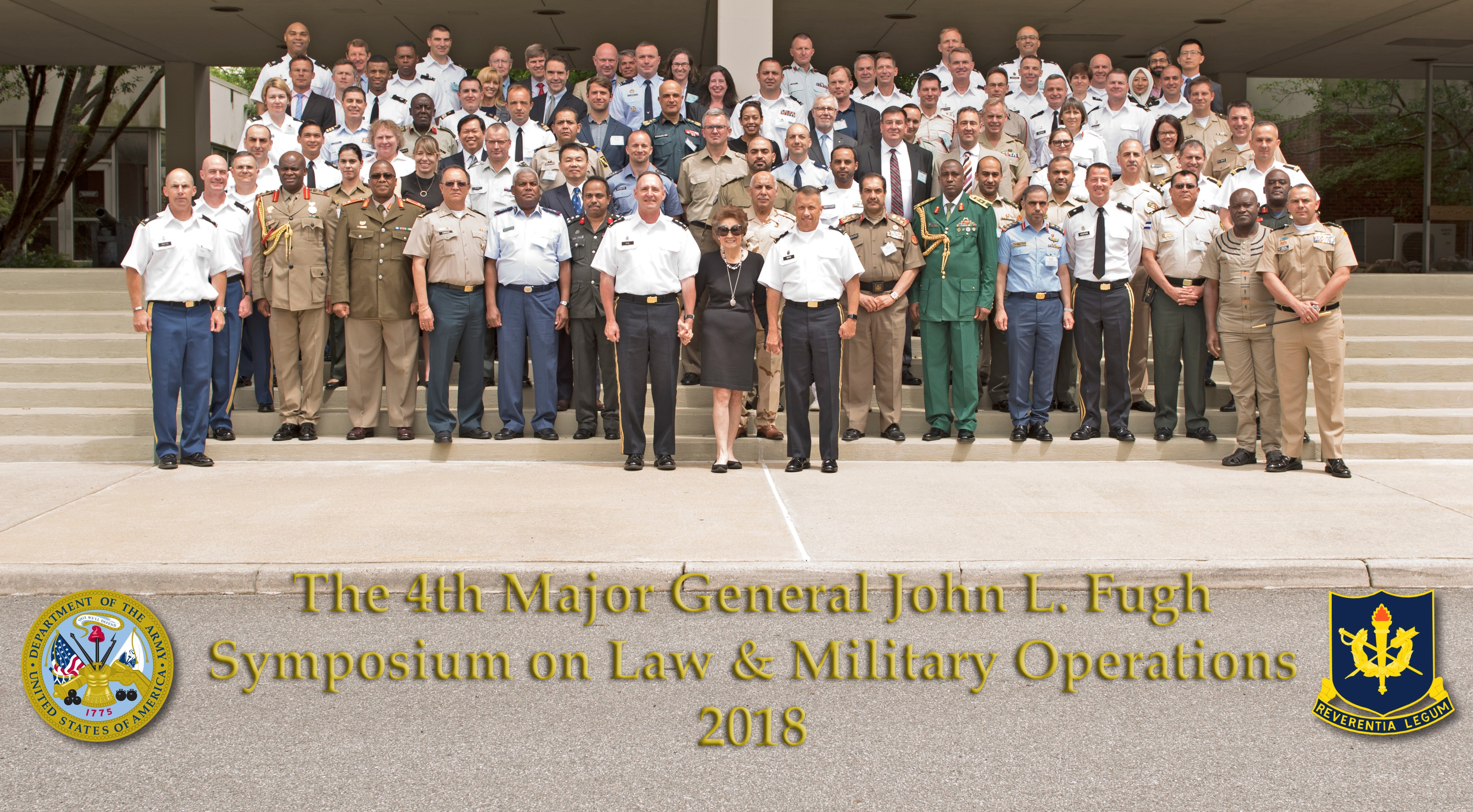 Military and academic legal experts from around the world were invited to discuss issues in the law of armed conflict at the 4th annual Maj. Gen. John L. Fugh and Multinational Interoperability Symposium, conducted at The Judge Advocate General Legal Center and School in Charlottesville, Va., May 28-29, 2018. Center is Ms. June Chung, Maj. Gen. Fugh's widow; on Ms. Chung's left is Lt. Gen. Charles N. Pede, The Judge Advocate General, U.S. Army; on Ms. Chung's right is Maj. Gen. Stuart W. Risch, The Deputy Judge Advocate General, U.S. Army. (Photo by Aliza Reisberg, The Judge Advocate General's Legal Center and School (TJAGLCS))