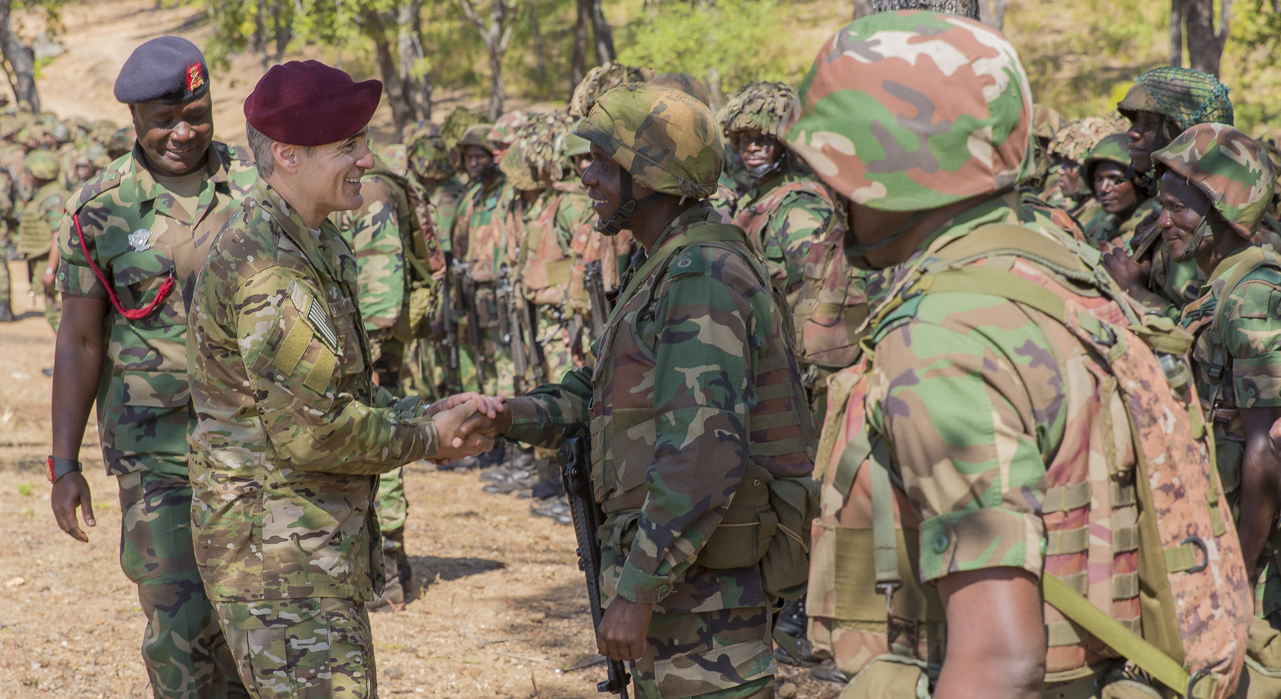 U.S. Africa Command Senior Enlisted Leader Command Chief Master Sgt. Ramon Colon-Lopez congratulates Malawi Defence Force Soldiers on graduating the Malawi Battalion Training Course in Malawi, Africa, May 31, 2018. Colon-Lopez travelled to Malawi to meet with the Malawi Defence Force, engaging with both senior officer and enlisted leadership as part of a three-day tour. The visit included a follow-up on issues addressed by the MDF during the Africa Senior Enlisted Leader Conference in November 2017, as well as assess the MDF's capability to train and sustain Peace Keeping Operations Forces.