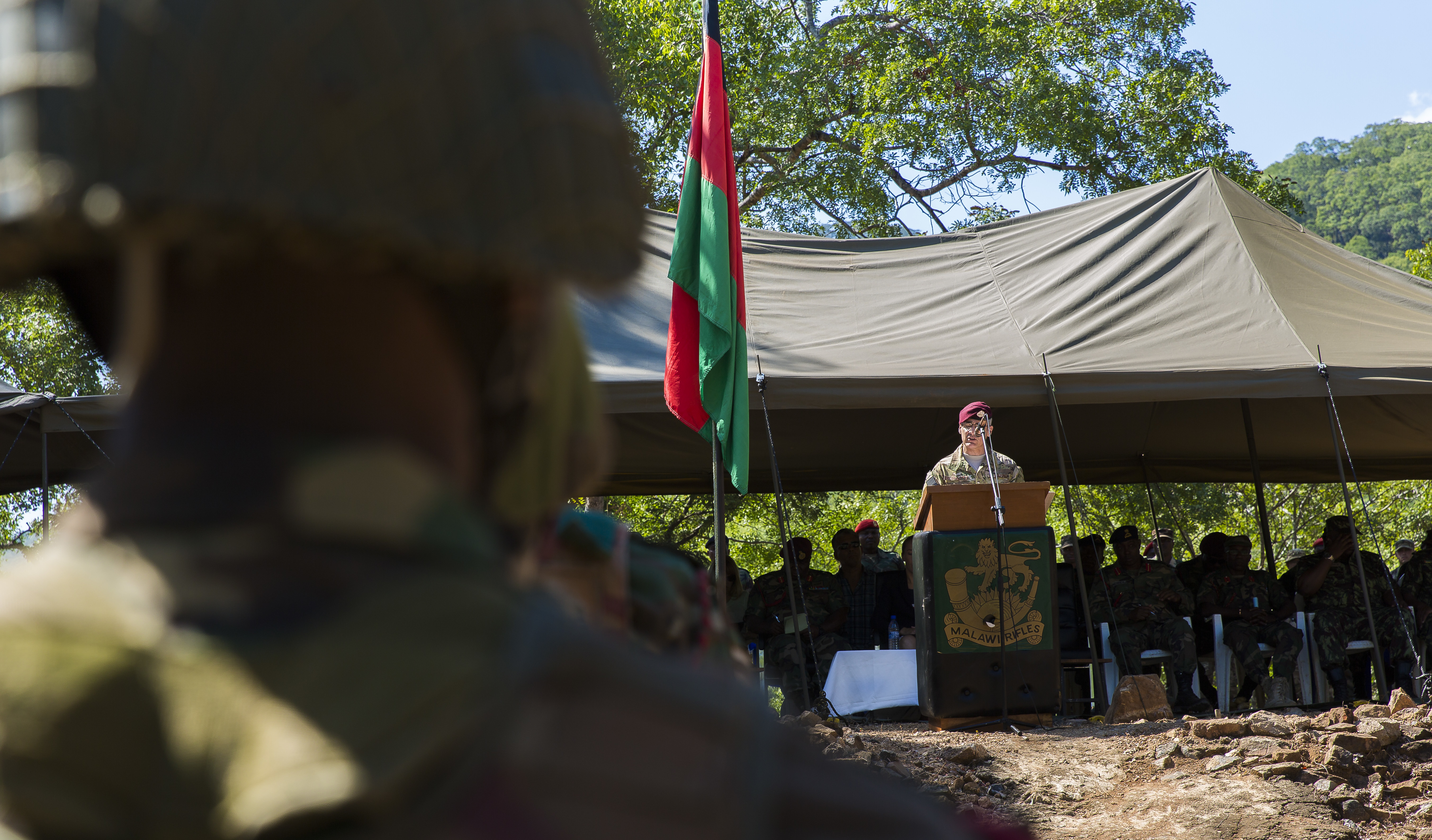 U.S. Africa Command Senior Enlisted Leader Command Chief Master Sgt. Ramon Colon-Lopez conducts a speech at the Malawi Battalion Training Site Graduation Ceremony on May 31, 2018 in Malawi, Africa. Colon-Lopez congratulates the soldiers on the hard work and perseverance and wishes them luck on their upcoming deployment. Colon-Lopez travelled to Malawi to meet with the Malawi Defence Force, engaging with both senior officer and enlisted leadership as part of a three-day tour. The visit included a follow-up on issues addressed by the MDF during the Africa Senior Enlisted Leader Conference in November 2017, as well as assess the MDF's capability to train and sustain Peace Keeping Operations Forces.
