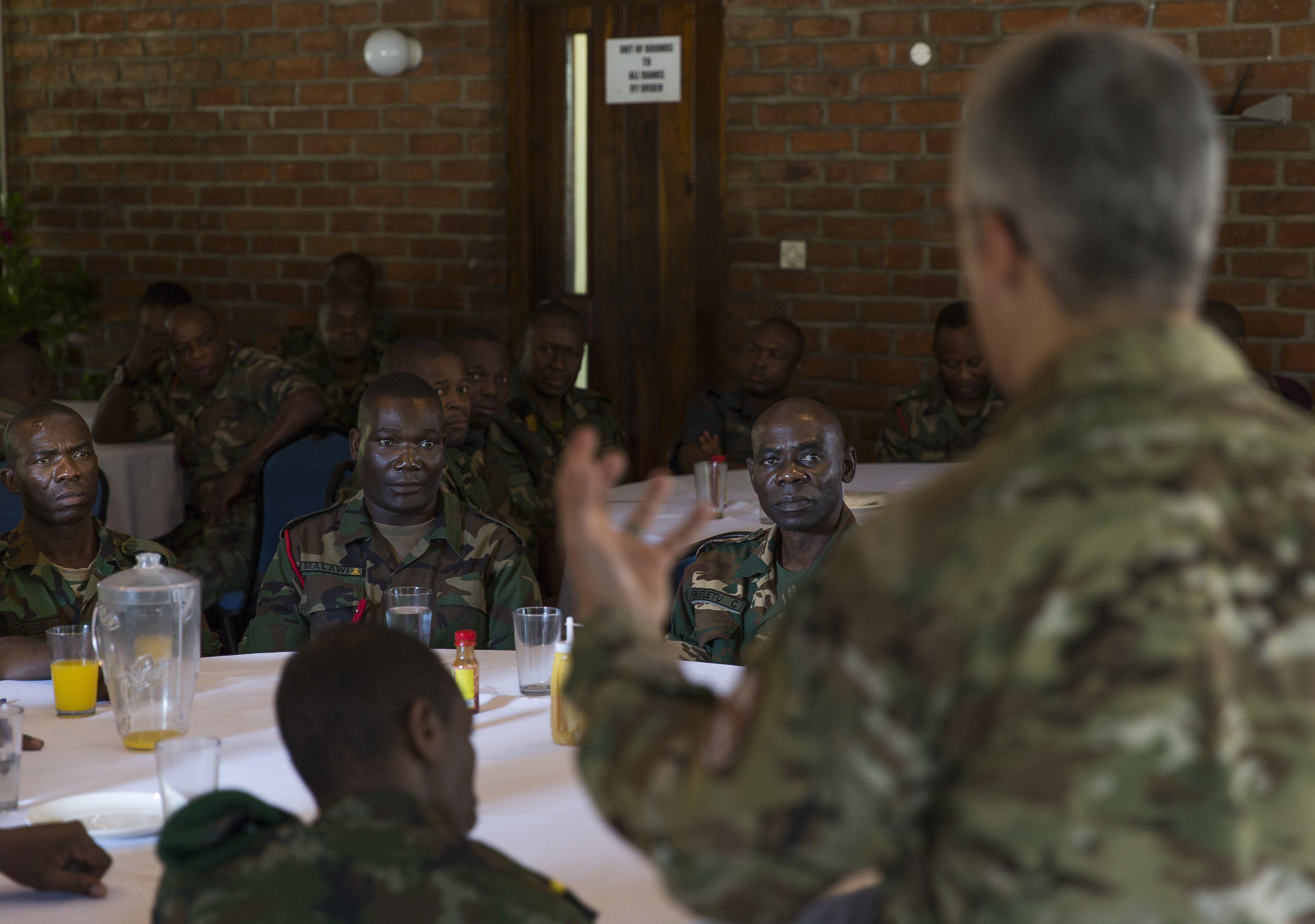 U.S. Africa Command Senior Enlisted Leader Command Chief Master Sgt. Ramon Colon-Lopez talks with students at the Malawi Armed Forces College Sergeant Major Academy in Malawi, Africa, June 1, 2018. Colon-Lopez answers questions and talks about ways to improve the Malawi Defence Force enlisted corps. Colon-Lopez travelled to Malawi to meet with the Malawi Defence Force, engaging with both senior officer and enlisted leadership as part of a three-day tour. The visit included a follow-up on issues addressed by the MDF during the Africa Senior Enlisted Leader Conference in November 2017, as well as assess the MDF's capability to train and sustain Peace Keeping Operations Forces.