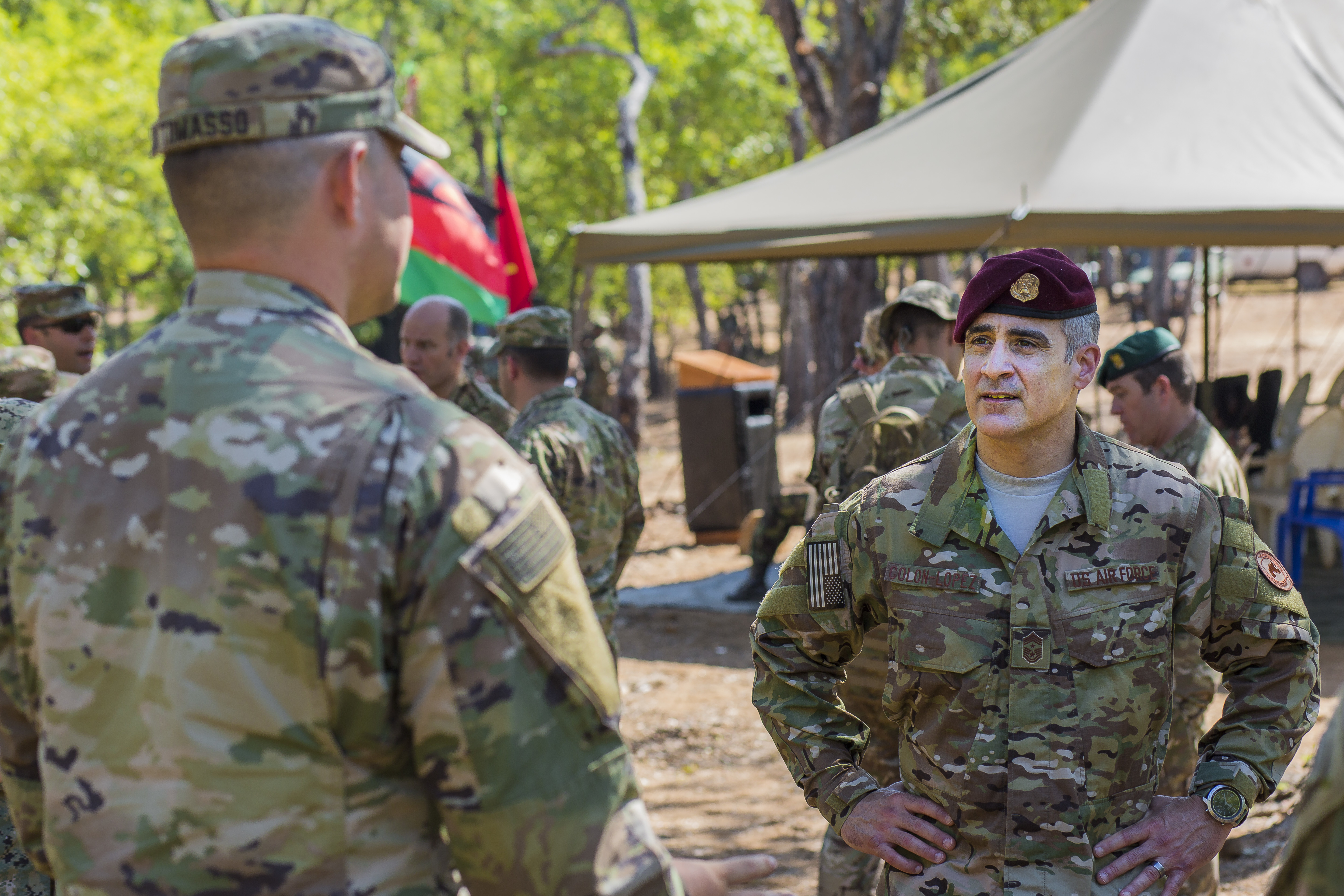 U.S. Africa Command Senior Enlisted Leader Command Chief Master Sgt. Ramon Colon-Lopez meets with U.S. Army soldiers who helped train the Malawi Defence Force during the Malawi Battalion Training Course in Malawi, Africa, May 31, 2018. Colon-Lopez travelled to Malawi to meet with the Malawi Defence Force, engaging with both senior officer and enlisted leadership as part of a three-day tour. The visit included a follow-up on issues addressed by the MDF during the Africa Senior Enlisted Leader Conference in November 2017, as well as assess the MDF's capability to train and sustain Peace Keeping Operations Forces.