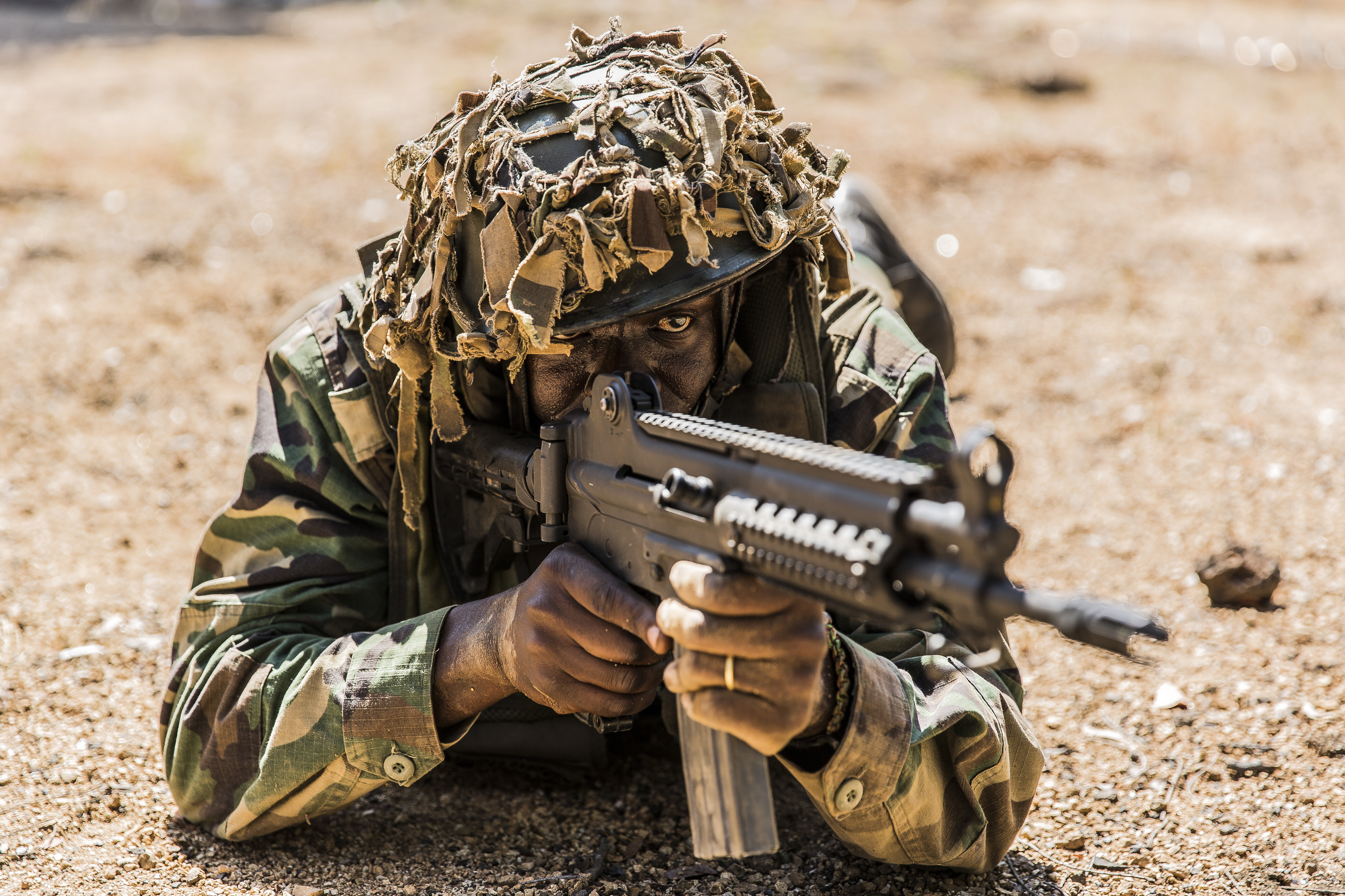 A Malawi Defence Force soldier keeps his sights downrange during a final exercise to conclude a pre-deployment Malawi Battalion Training Course in Malawi, Africa, May 31, 2018. U.S. Africa Command Senior Enlisted Leader Command Chief Master Sgt. Ramon Colon-Lopez and his team traveled to the MALBAT Training Site to follow-up on issues addressed by the MDF during the Africa Senior Enlisted Leader Conference in November 2017, and to assess the MDF's capability to train and sustain Peace Keeping Operations Forces.