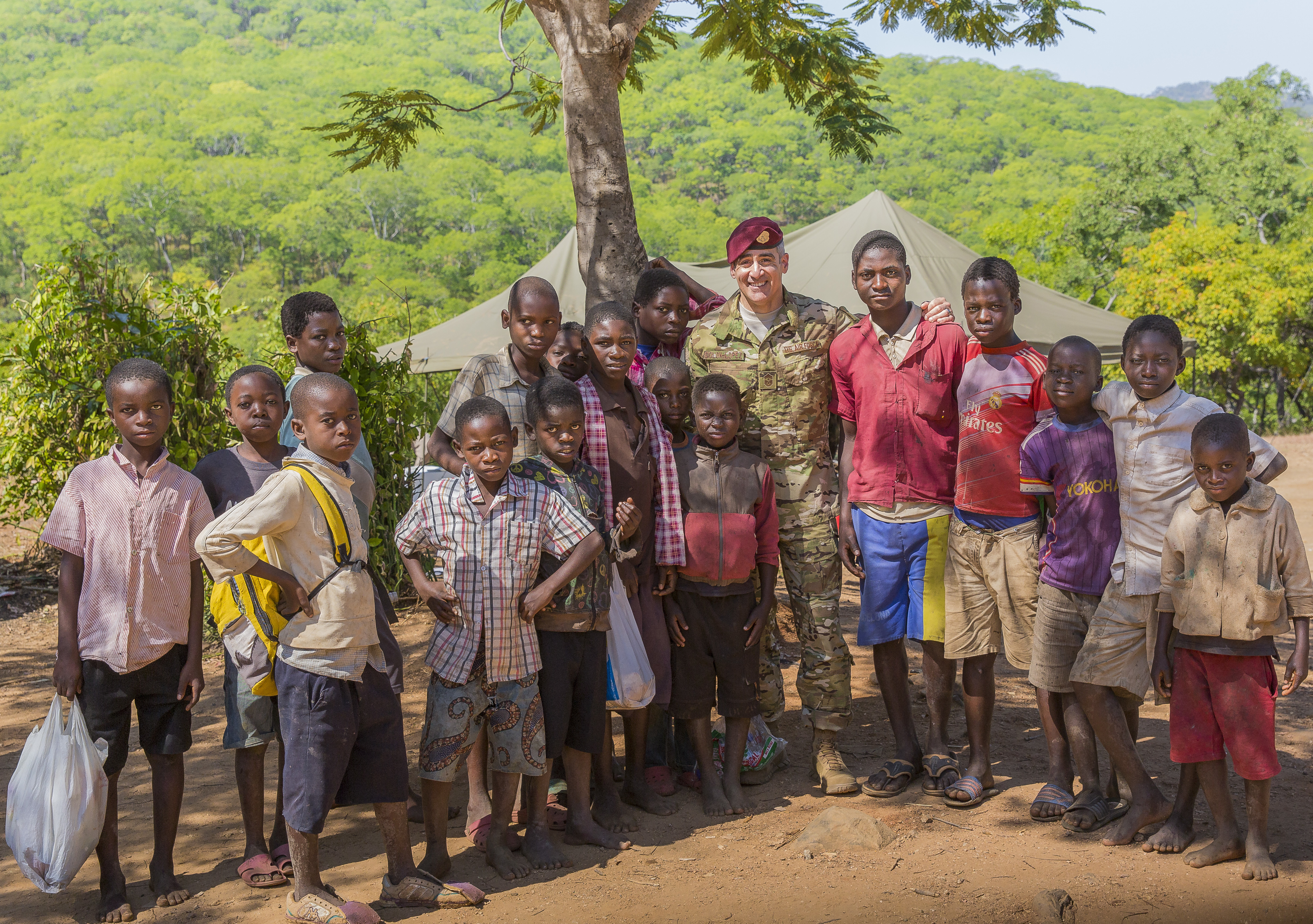 U.S. Africa Command Senior Enlisted Leader Command Chief Master Sgt. Ramon Colon-Lopez takes a moment to say hello to local children during the Malawi Battalion Training Course graduation in Malawi, Africa, May 31, 2018. Colon-Lopez travelled to Malawi to meet with the Malawi Defence Force, engaging with both senior officer and enlisted leadership as part of a three-day tour. The visit included a follow-up on issues addressed by the MDF during the Africa Senior Enlisted Leader Conference in November 2017, as well as assess the MDF's capability to train and sustain Peace Keeping Operations Forces.