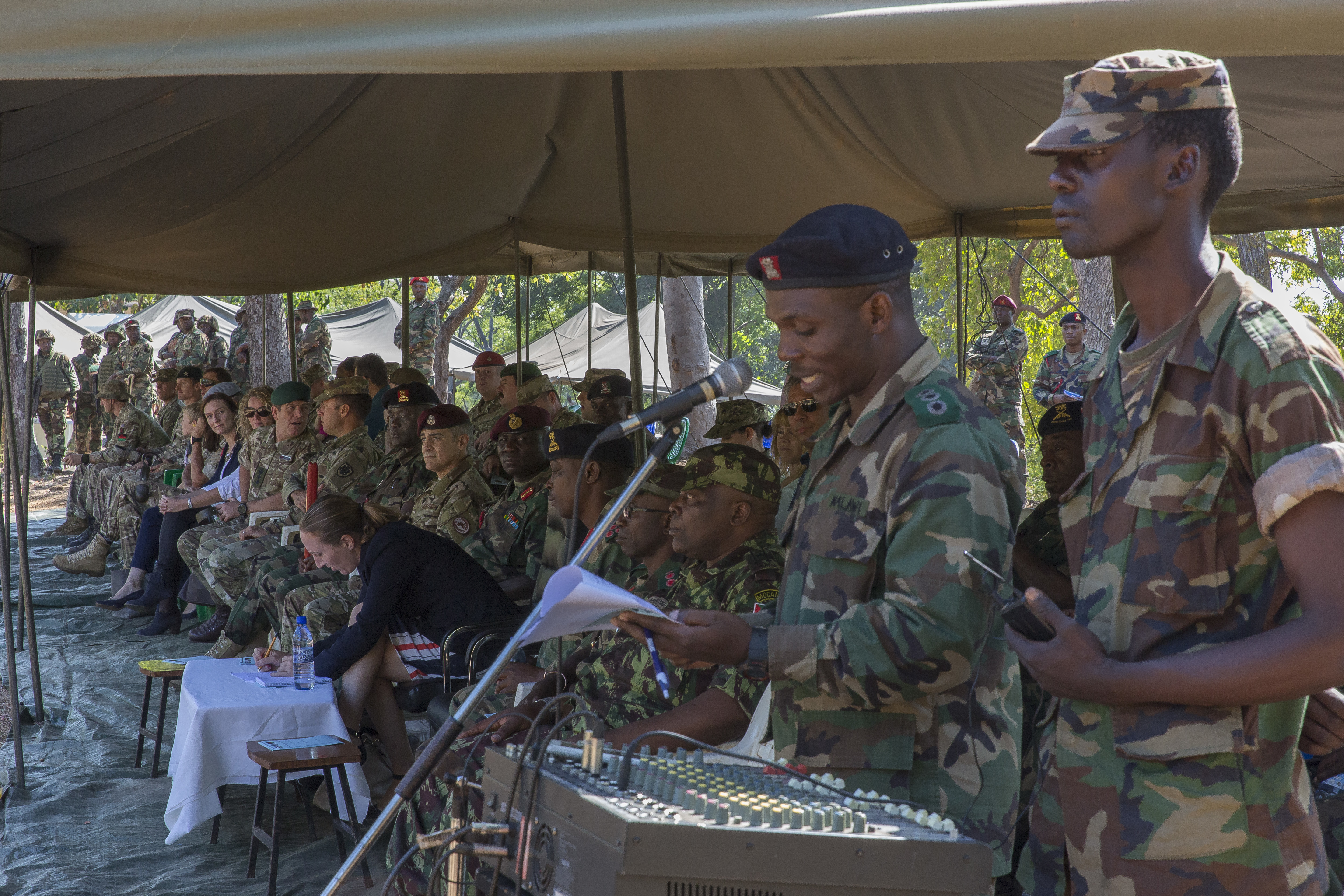 U.S. Africa Command Senior Enlisted Leader Command Chief Master Sgt. Ramon Colon-Lopez sits with Malawi Defence Force Leaders and observes MDF soldiers as they perform their final exercise at the Malawi Battalion Training Site, May 31, 2018. Colon-Lopez travelled to Malawi to meet with the Malawi Defence Force, engaging with both senior officer and enlisted leadership as part of a three-day tour. The visit included a follow-up on issues addressed by the MDF during the Africa Senior Enlisted Leader Conference in November 2017, as well as assess the MDF's capability to train and sustain Peace Keeping Operations Forces.