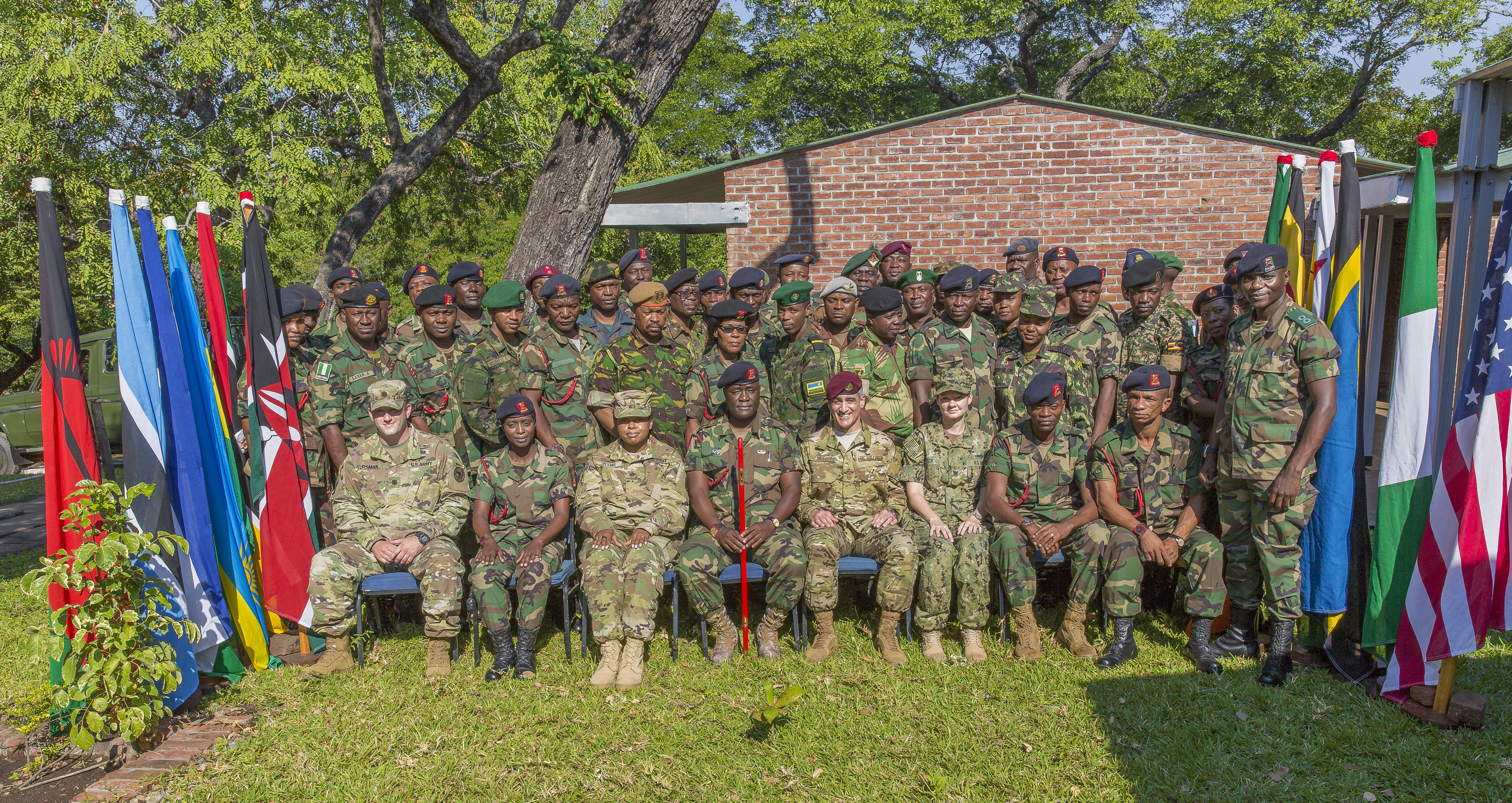 U.S. Africa Command Senior Enlisted Leader Command Chief Master Sgt. Ramon Colon-Lopez and students at the Malawi Armed Forces College Sergeant Major Academy, pose for a photo after discussing ways to improve the Malawi enlisted force in Malawi, Africa, June 1, 2018. Colon-Lopez travelled to Malawi to meet with the Malawi Defence Force, engaging with both senior officer and enlisted leadership as part of a three-day tour. The visit included follow-ups on issues addressed by the MDF during the Africa Senior Enlisted Leader Conference in November 2017, as well as assess the MDF's capability to train and sustain Peace Keeping Operations Forces.