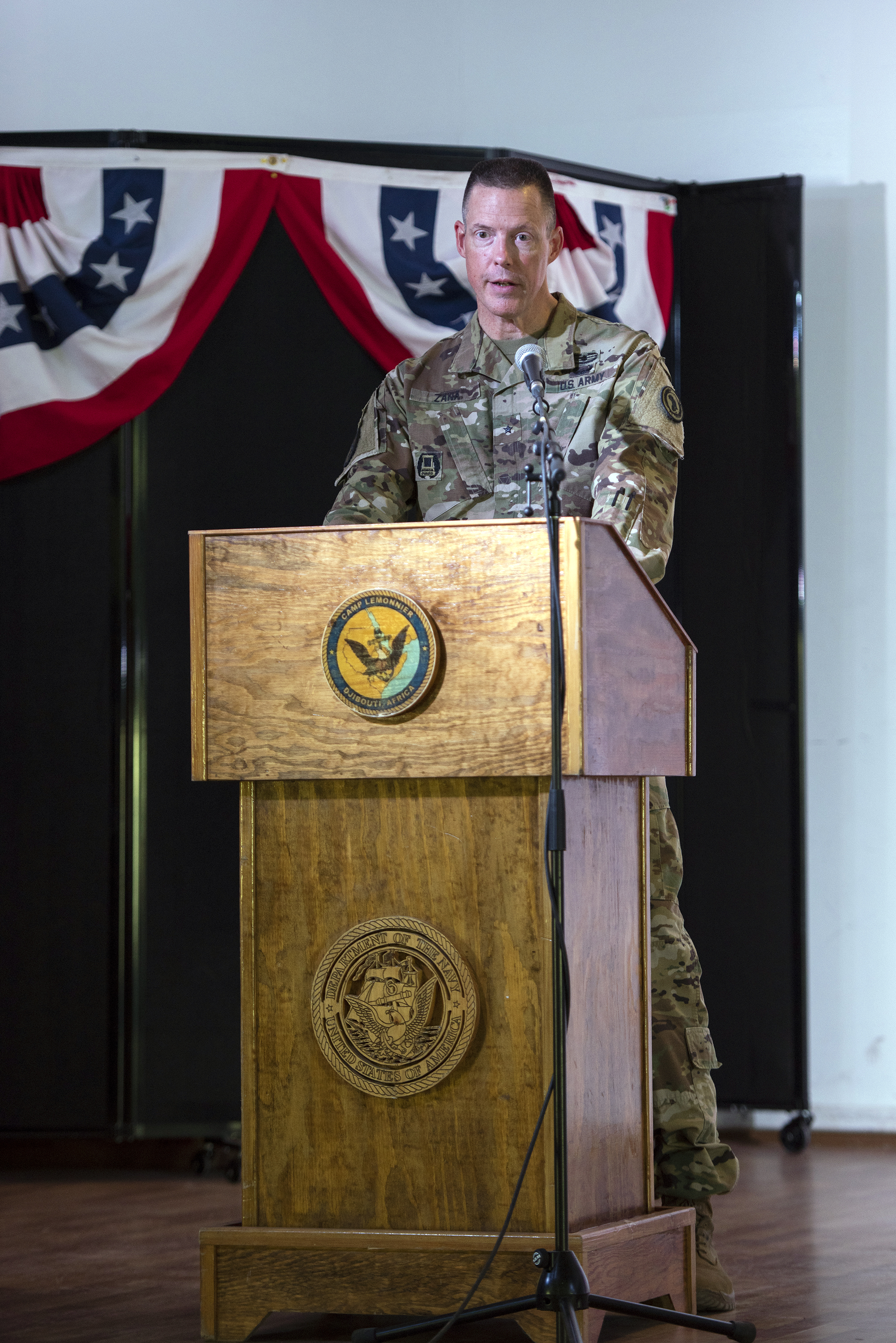 U.S. Army Brig. Gen. William Zana, outgoing commander, Combined Joint Task Force Horn of Africa, addresses distinguished guests and service members during a change of command ceremony on Camp Lemonnier, Djibouti, June 14, 2018. Zana, the fifteenth leader to command CJTF-HOA, will continue to serve with the task force, resuming his previous position as deputy commander. (U.S. Air National Guard photo by Master Sgt. Sarah Mattison)