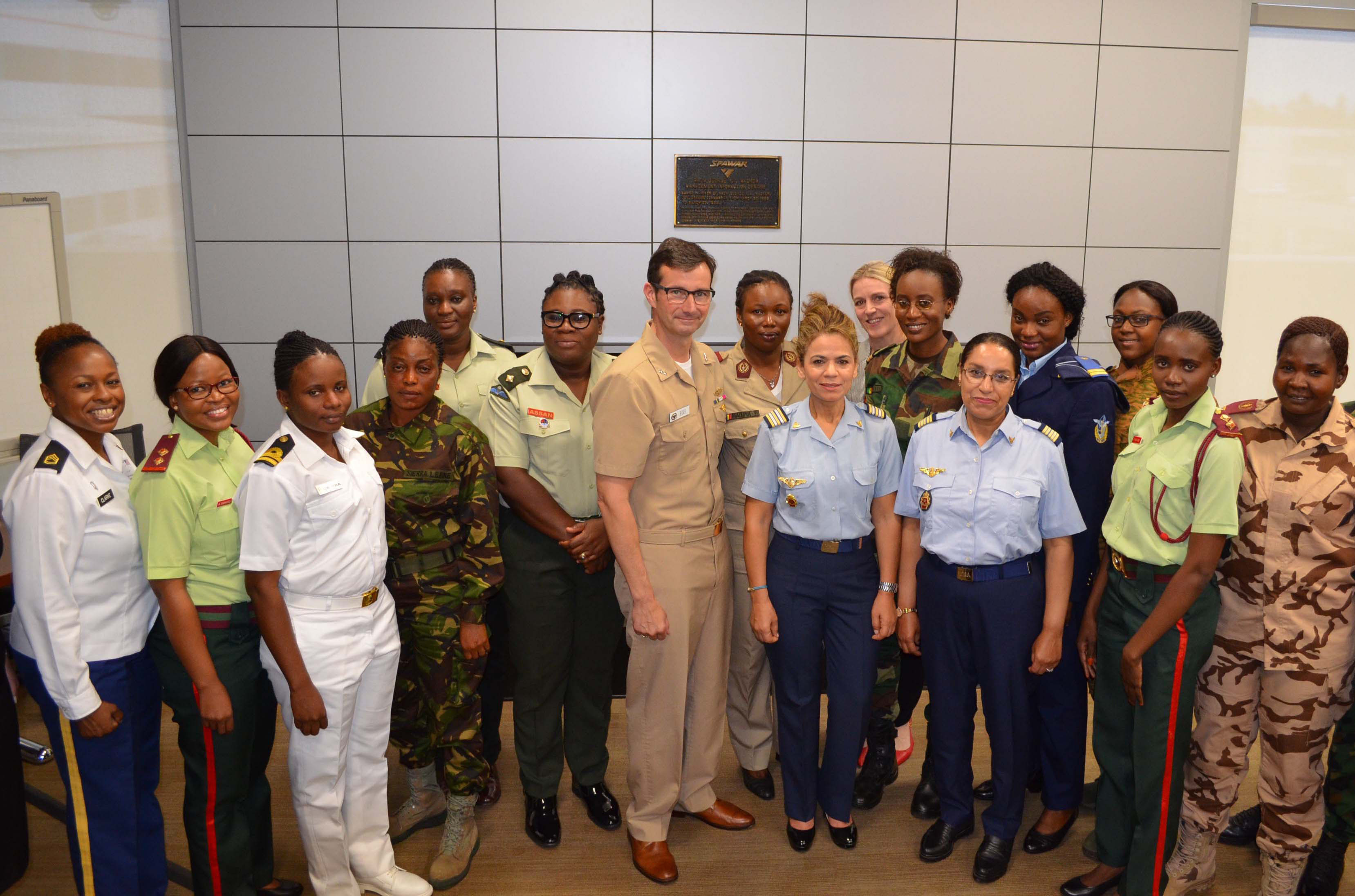 Navy Rear Adm. Christian Becker, commander, Space and Naval Warfare Systems Command (center), welcomes a delegation of African women military communications specialists June 19 aboard SPAWAR Headquarters as part of U.S. Africa Command's Women's Military-to-Military Engagement Program. U.S. Navy photo by Steven A. Davis (Released) 180619-N-PJ405-002