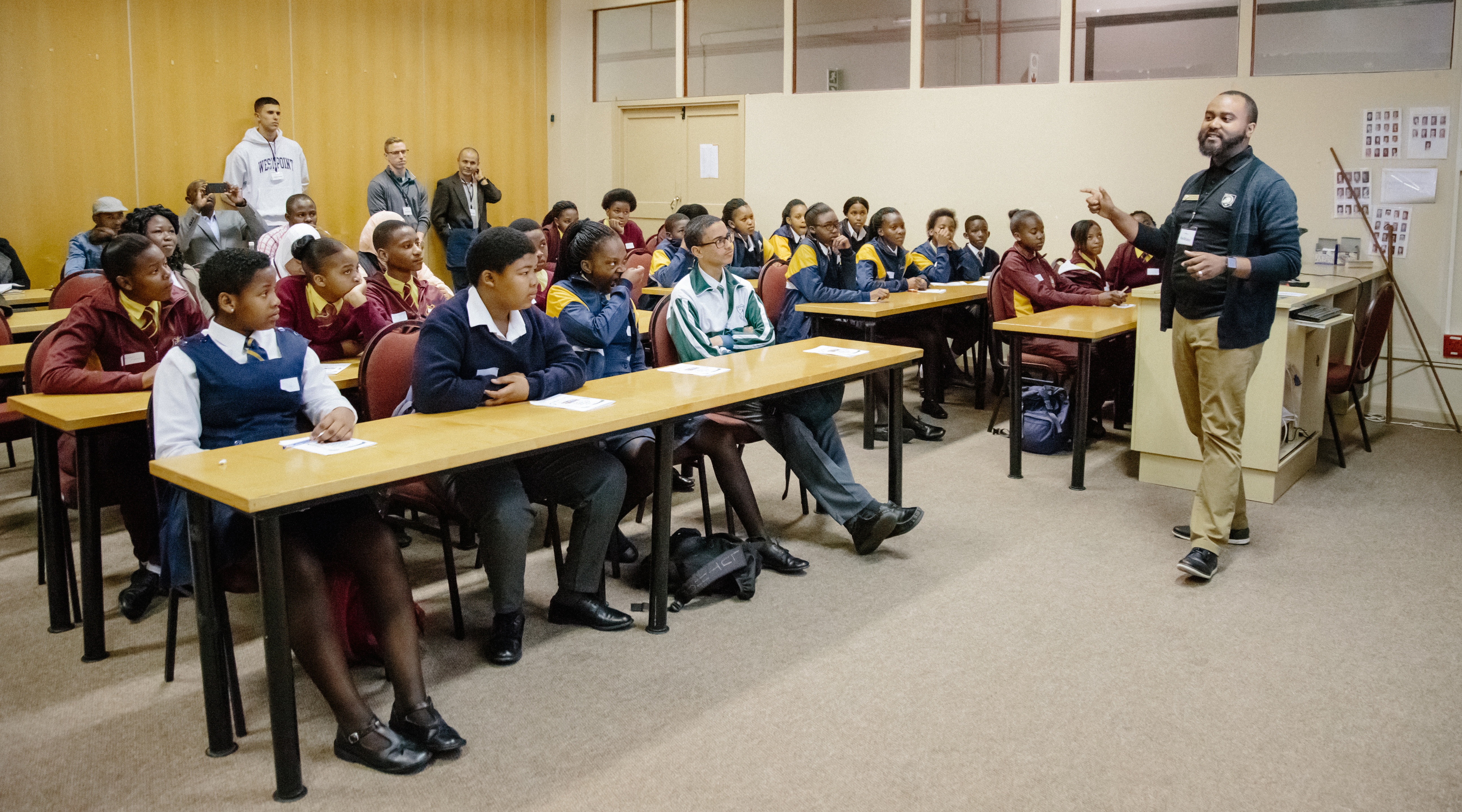 U.S. Military Academy mathematics professor Dr. Samuel Ivy lectures South African students to promote Science; Technology; Engineering and Math (STEM) education as part of the U.S. Africa Command outreach efforts with the African Institute for Mathematical Sciences in Muizenberg; South Africa; June 25; 2018. Ivy was joined by two West Point cadets to help facilitate learning and foster confidence in STEM for the African students. (Photo courtesy Yasmin Hankel; AIMS Media Specialist)