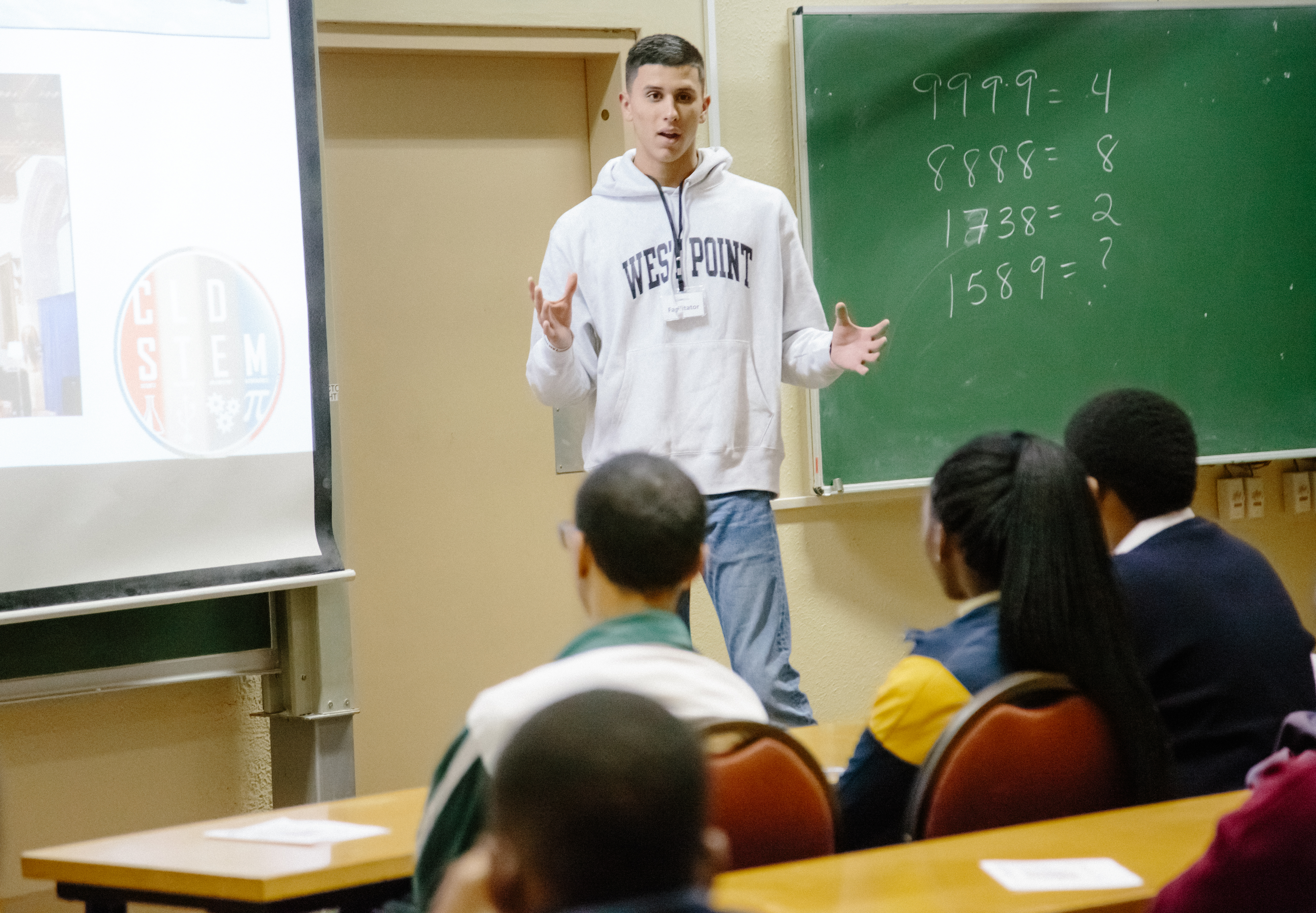 U.S. Military Academy Cadet Matthew Rivera provides an overview of the education programs offered at West Point to South African students in order to promote Science, Technology, Engineering and Math (STEM) education as part of the U.S. Africa Command outreach efforts with the African Institute for Mathematical Sciences in Muizenberg, South Africa, June 25, 2018. Rivera was joined by fellow Cadet Patrick Cowan and Mathematics Professor Dr. Samuel Ivy to help facilitate learning and foster confidence in STEM for the African students. (Photo courtesy Yasmin Hankel, AIMS Media Specialist)