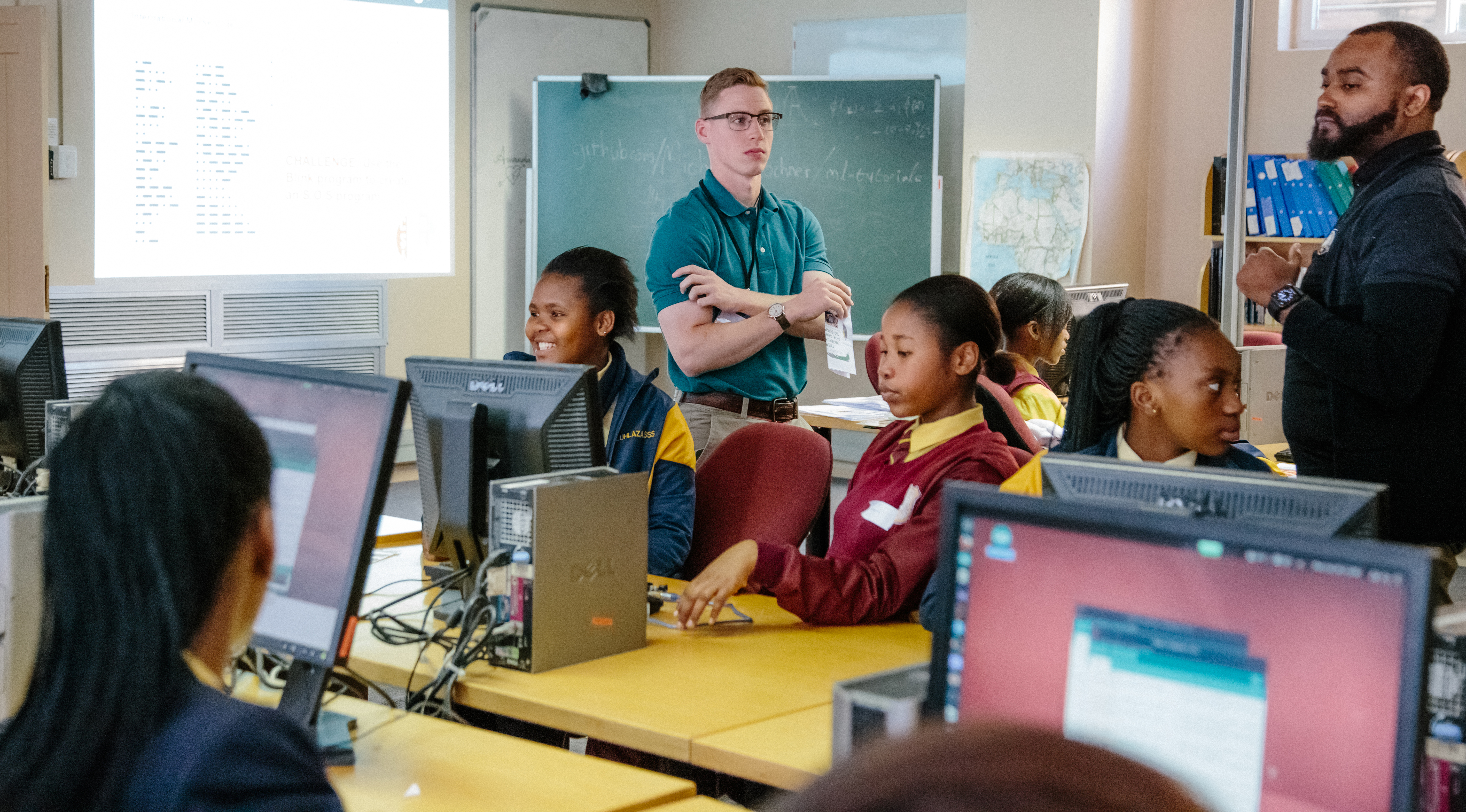 U.S. Military Academy Cadet Patrick Cowan, center, and Mathematics Professor Dr. Samuel Ivy assist South African students during practical exercises to promote Science, Technology, Engineering and Math (STEM) education as part of the U.S. Africa Command outreach efforts with the African Institute for Mathematical Sciences in Muizenberg, South Africa, June 25, 2018. (Photo courtesy Yasmin Hankel, AIMS Media Specialist)