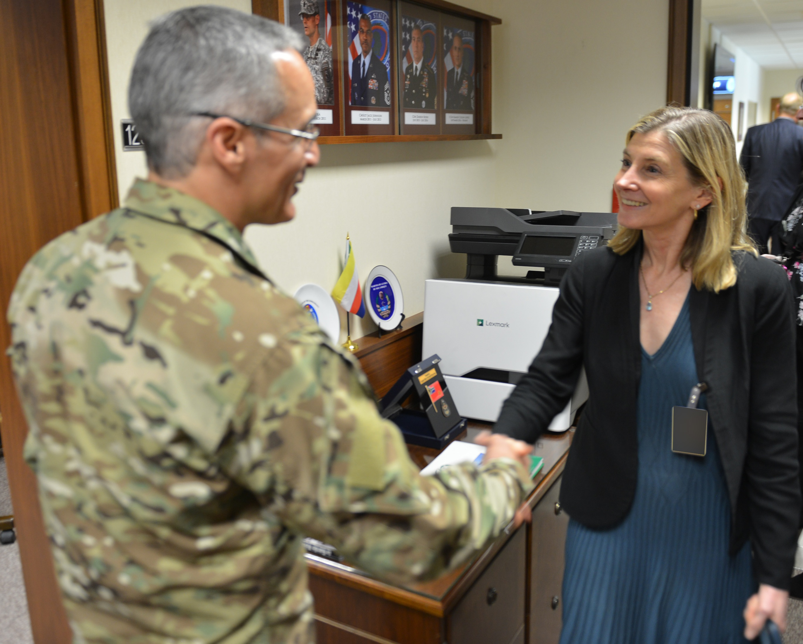 STUTTGART, Germany – The United States Institute of Peace President, Nancy Lindborg, shakes hands with Chief Master Sgt. Ramon Colon-Lopez, Senior Enlisted Leader, U.S. Africa Command, during her visit to the command's headquarters, Stuttgart, Germany. (Photo by Army Staff Sgt. Grady Jones, AFRICOM Public Affairs)