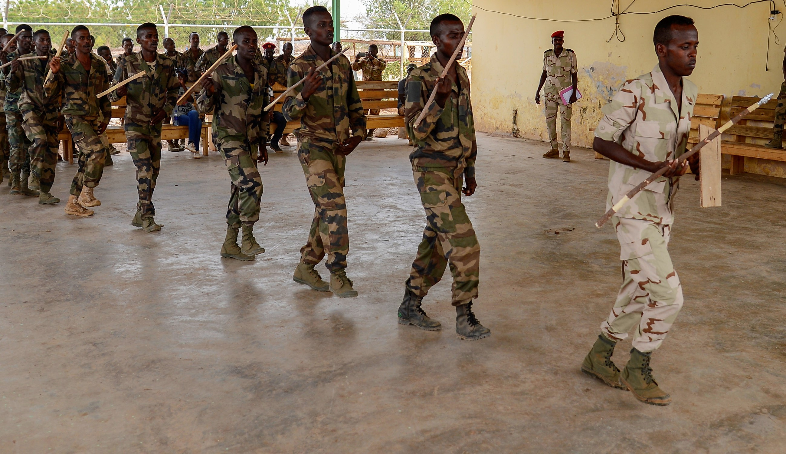 Members of the Djiboutian Army's Rapid Intervention Battalion (RIB) perform a traditional Afar dance during a celebration for new RIB graduates at a training site outside Djibouti City, June 28, 2018. The RIB is a U.S. Army trained unit that was formed to respond to crises and promote regional security and stability in East Africa. (U.S. Navy Photo by Mass Communication Specialist 2nd Class Timothy M. Ahearn)