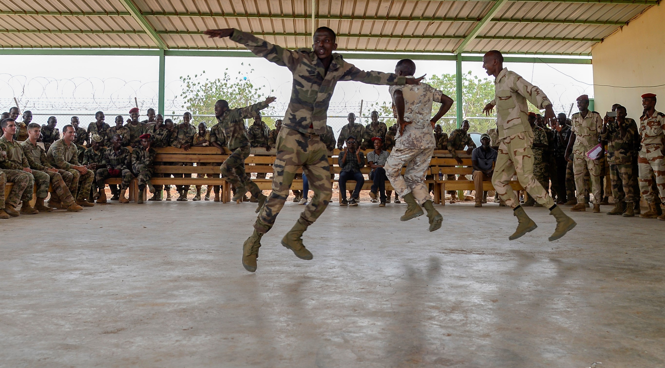 Members of the Djiboutian Army's Rapid Intervention Battalion (RIB) perform a traditional Somali dance during a celebration for new RIB graduates at a training site outside Djibouti City, June 28, 2018. The RIB is a U.S. Army trained unit that was formed to respond to crises and promote regional security and stability in East Africa. (U.S. Navy Photo by Mass Communication Specialist 2nd Class Timothy M. Ahearn)