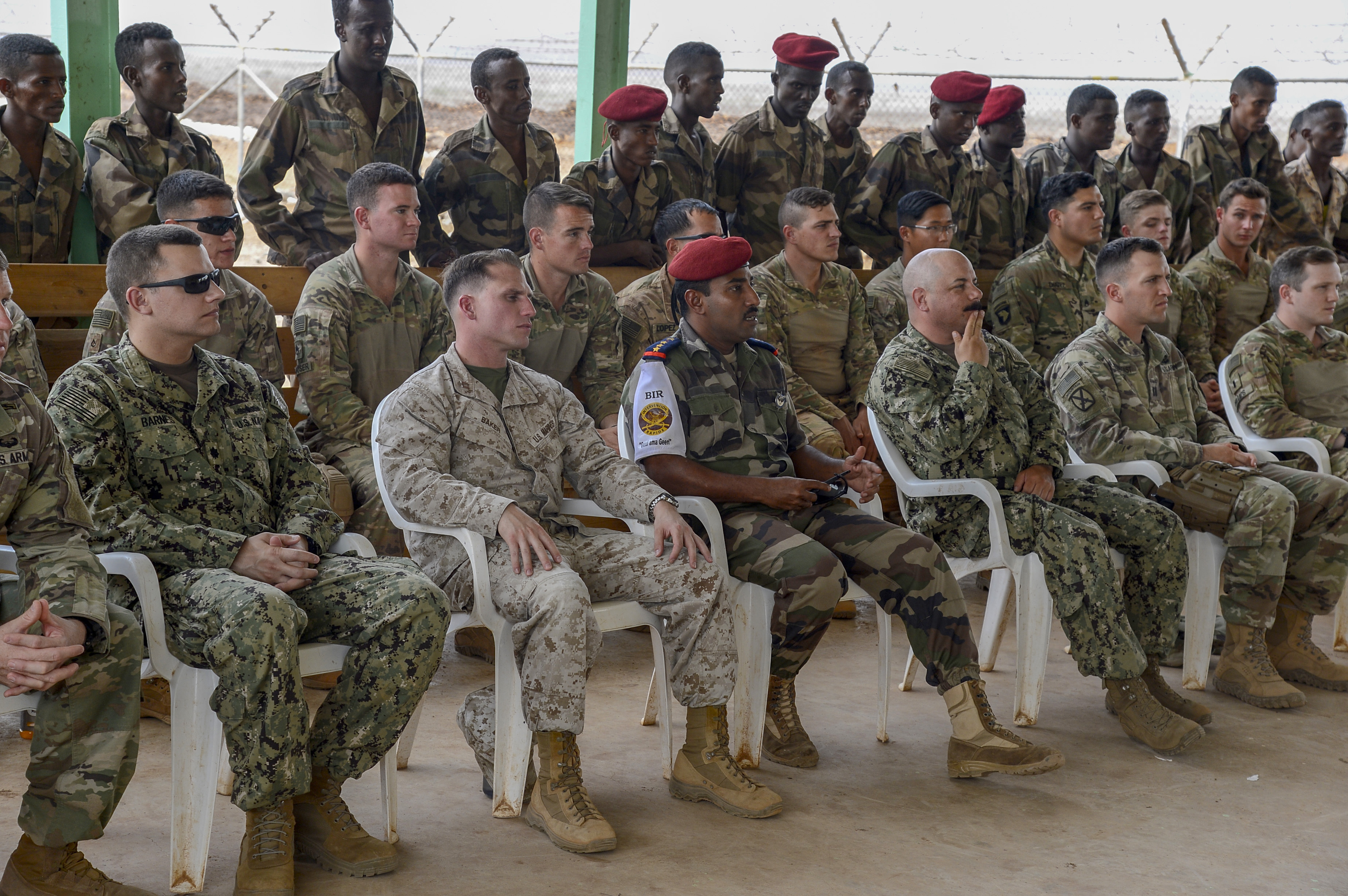 Members of the Djiboutian Army's Rapid Intervention Battalion (RIB) and Combined Joint Task Force-Horn of Africa attend a celebration for new RIB graduates at a training site outside Djibouti City, June 28, 2018. The RIB is a U.S. Army trained unit that was formed to respond to crises and promote regional security and stability in East Africa. (U.S. Navy Photo by Mass Communication Specialist 2nd Class Timothy M. Ahearn)