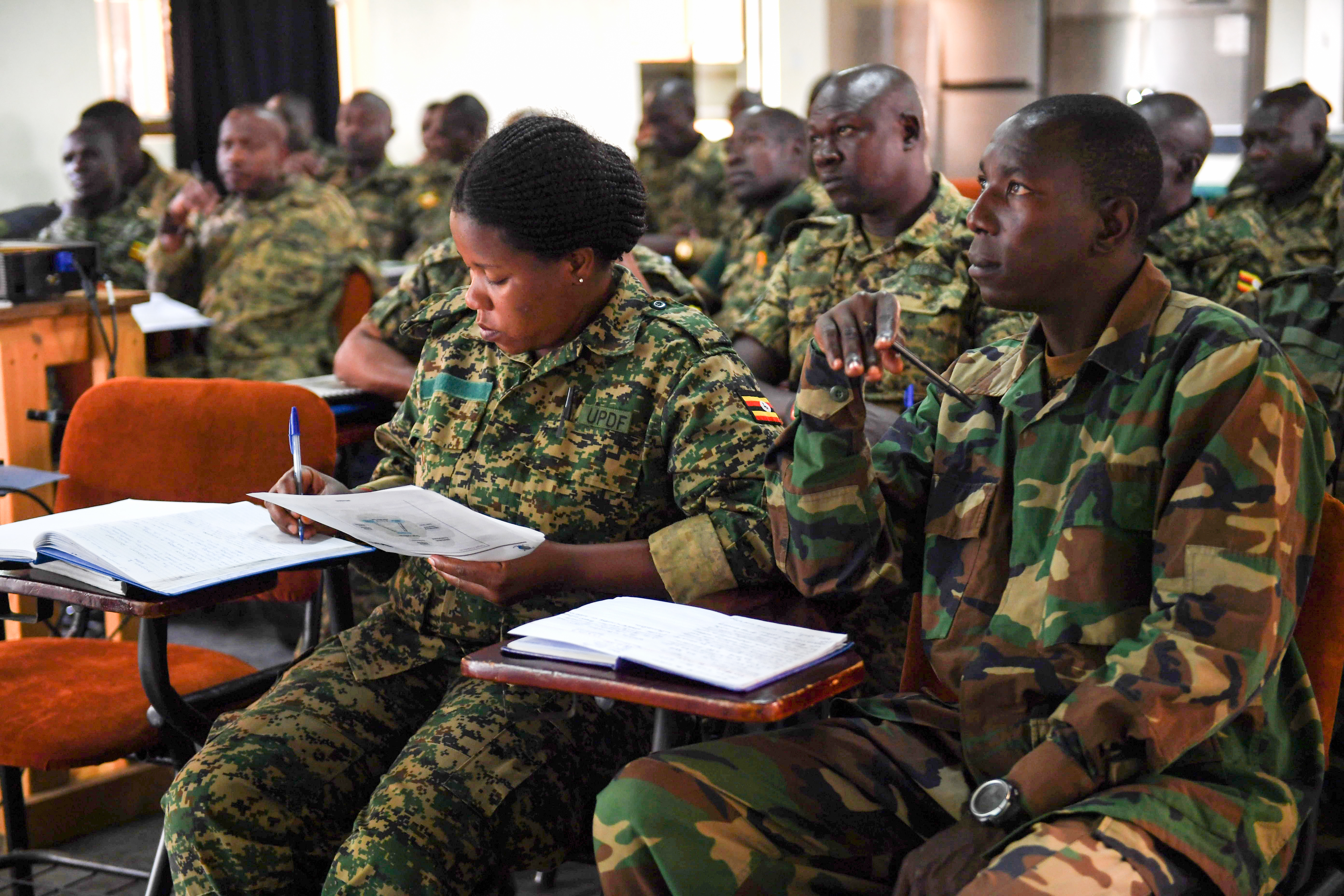 Uganda Peoples' Defence Force soldiers take notes during a training brief in Entebee, Uganda, July 11, 2018. The training is designed to enhance the UPDF's capability and capacity to support the African Union Mission in Somalia. (U.S. Air Force photo by Senior Airman Haley D. Phillips)