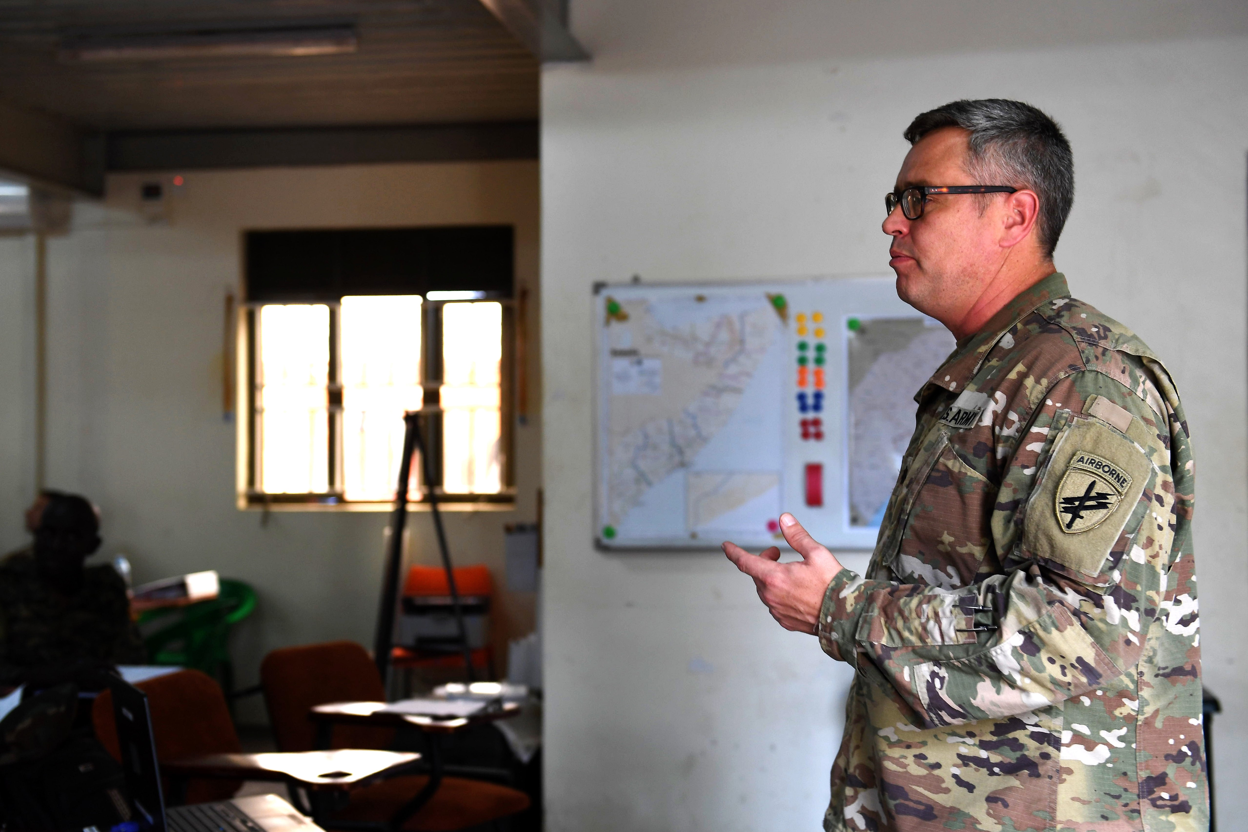 U.S. Army U.S. Army Lt. Col. Stefan Adamcik, 404th Civil Affairs Battalion Commander, briefs  Uganda Peoples' Defence Force (UPDF) Soldiers on the Civil Affairs mission, Entebee, Uganda,  July 10, 2018. The UDPF is participating in training designed to enhance their capability and capacity in support of the African Union Mission in Somalia. The 404th Civil Affairs Battalion, Airborne, based at Joint Base McGuire-Dix-Lakehurst, New Jersey, is currently deployed to  Combined Joint Task force-Horn of Africa, Djibouti.  (U.S. Air Force photo by Senior Airman Haley D. Phillips)