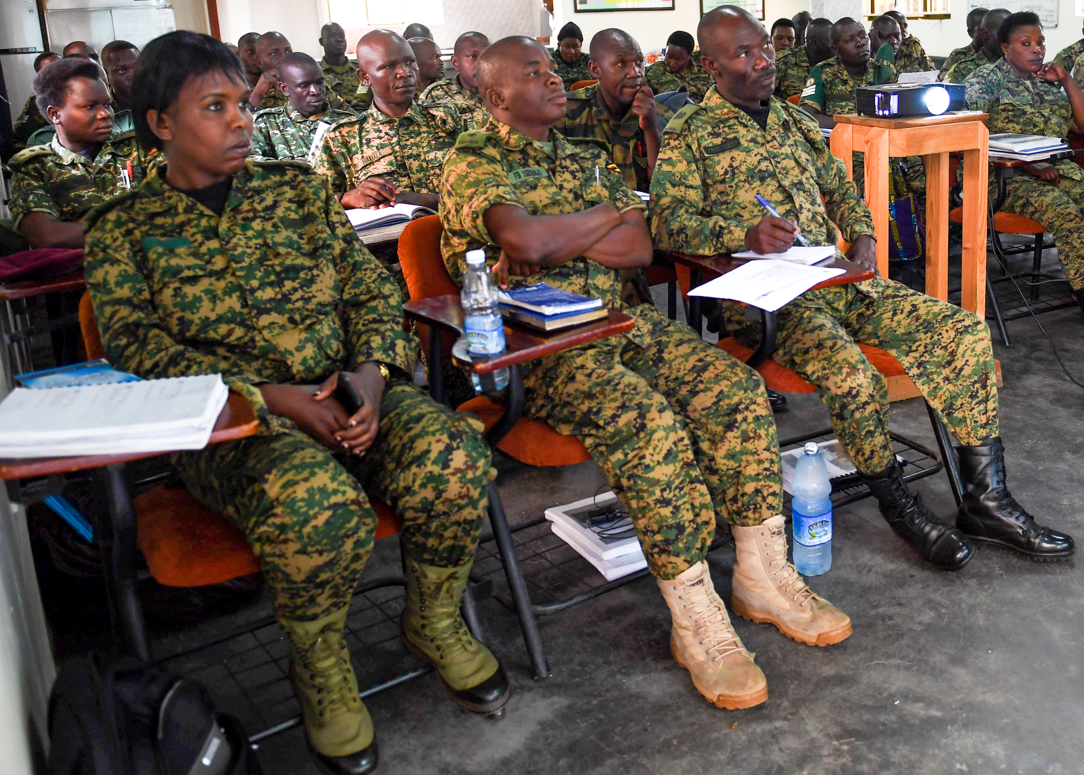 Uganda Peoples' Defence Force soldiers listen intently during a training brief in Entebee, Uganda, July 11, 2018.  The training is designed to enhance the UPDF's capability and capacity to the African Union Mission in Somalia. (U.S. Air Force photo by Senior Airman Haley D. Phillips)