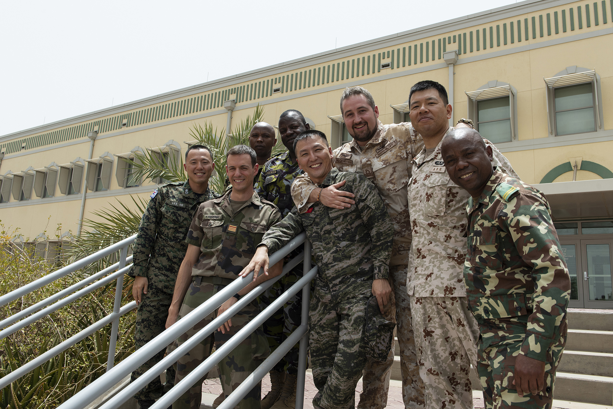 Foreign Liaison Officers pose for a friendly group photo outside of the CJTF-HOA headquarters building, July 18, 2018. Several partner nations send liaison officers to work alongside, support and train CJTF-HOA staff to help increase partner capacity, helping to establish a more secure, stable, and prosperous African continent. (U.S. Air National Guard photo by Master Sgt. Sarah Mattison)