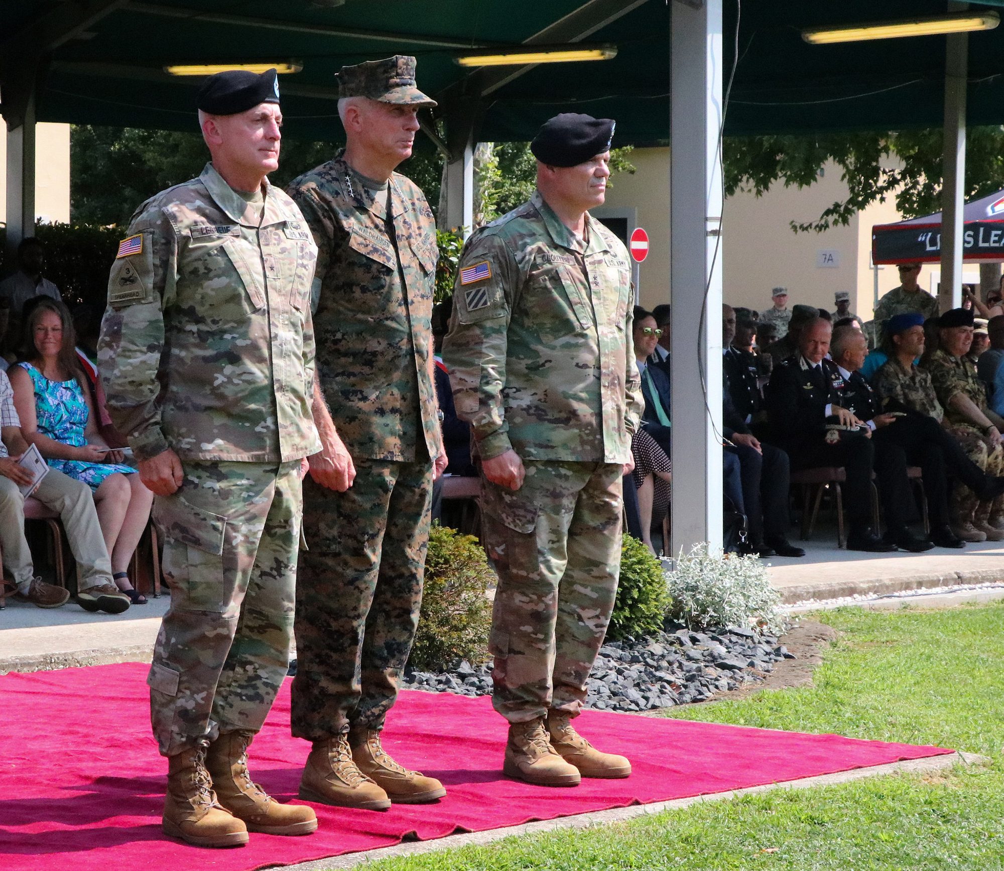 Brig. Gen. Eugene J. LeBoeuf, left, the outgoing U.S. Army Africa acting commanding general; Marine Gen. Thomas D. Waldhauser, center, the U.S. Africa Command commanding general; and Maj. Gen. Roger L. Cloutier, the incoming U.S. Army Africa commanding general, prepare for the passing of the guidon during the USARAF change of command ceremony, held at Caserma Ederle in Vicenza, Italy, Aug. 2, 2018. (U.S. Army photo by Sgt. Jennifer Garza)