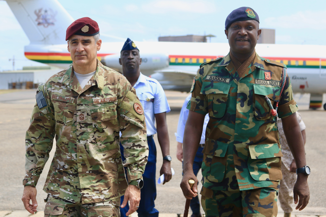 U.S. Air Force Chief Master Sgt. Ramon Colon-Lopez walks with Ghana Armed Forces's Sergeant Major, Chief Warrant Officer Ramous Barker, on Ghana Armed Forces's Burma Camp in Accra, August 6, 2018.  Colon-Lopez's visit included dialogue with Ghana Armed Forces's non-commissioned officers to shape Africa Command's plans to provide senior enlisted professional military education with partnering nations.