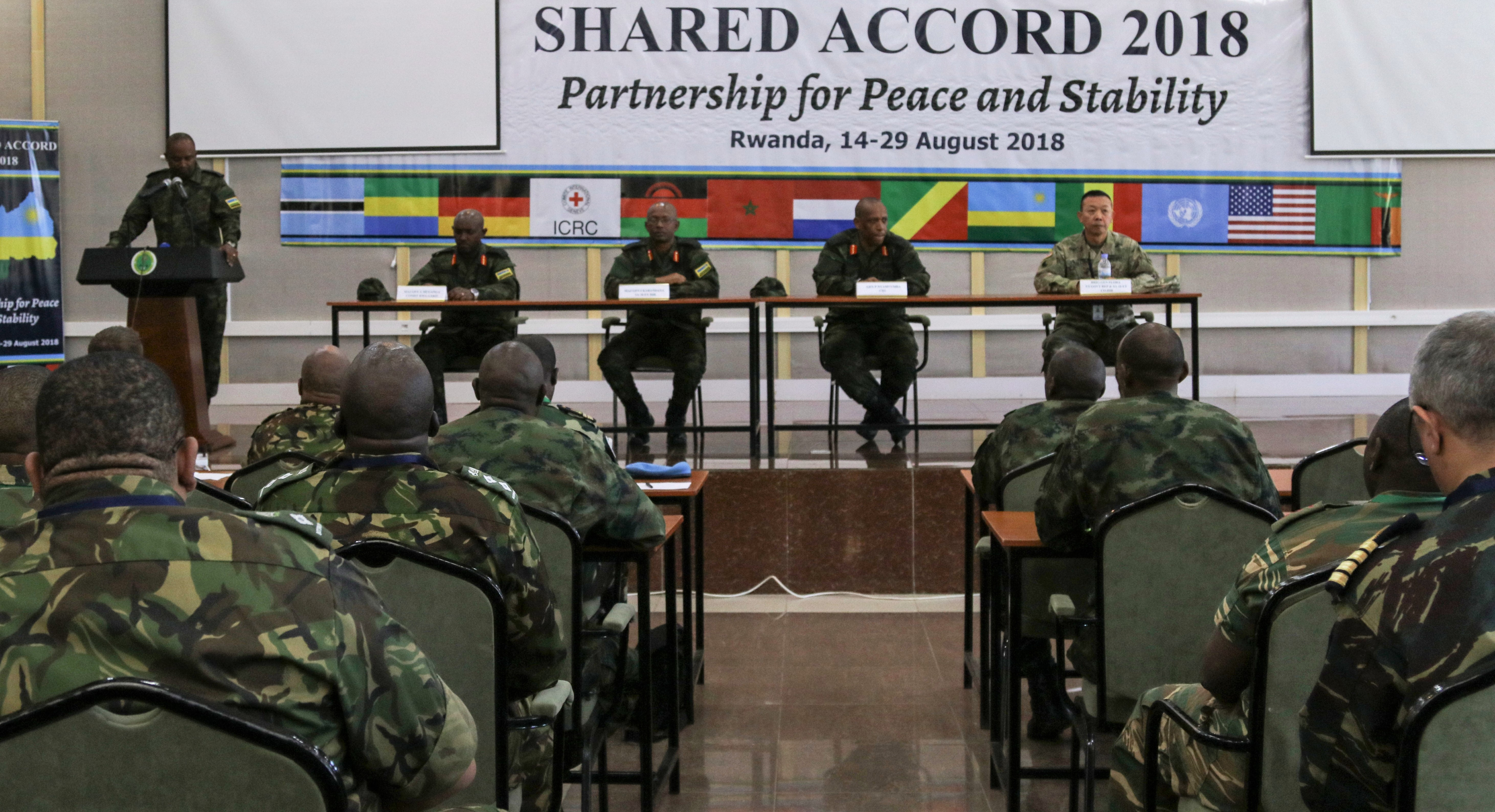 Shared accord opening ceremony commences at the Rwandan Military Academy in Gako, Rwanda, Aug.14, 2018. SA18, sponsored by U.S. Africa Command and executed by U.S. Army Africa (USARAF), trains participants on U.S., U.N., and African Union mandated peacekeeping operations by replicating real-world scenarios from the U.N. mission in the Central African Republic – Multidimensional Integrated Stabilization Mission in the Central African Republic (MINUSCA). (U.S. Army Photo by Sgt. Jennifer Garza)