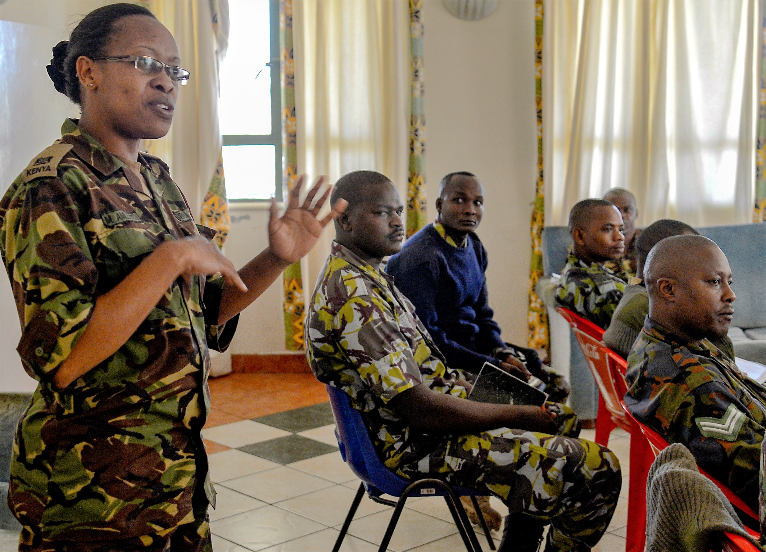Kenya Defense Force (KDF) Maj. Marion Amulyoto, a veterinarian with KDF's 1st Canine Regiment, discusses the hazards of heat exhaustion for military working dogs for members of the Kenyan Defense Force's 1st Canine Regiment during a  knowledge exchange, in Nairobi, Kenya, August 7, 2018. The exchange gave a chance for American and Kenyan forces to learn and work with each other to have a better understanding of each other's capabilities. (U.S. Navy Photo by Mass Communication Specialist 2nd Class Timothy M. Ahearn)