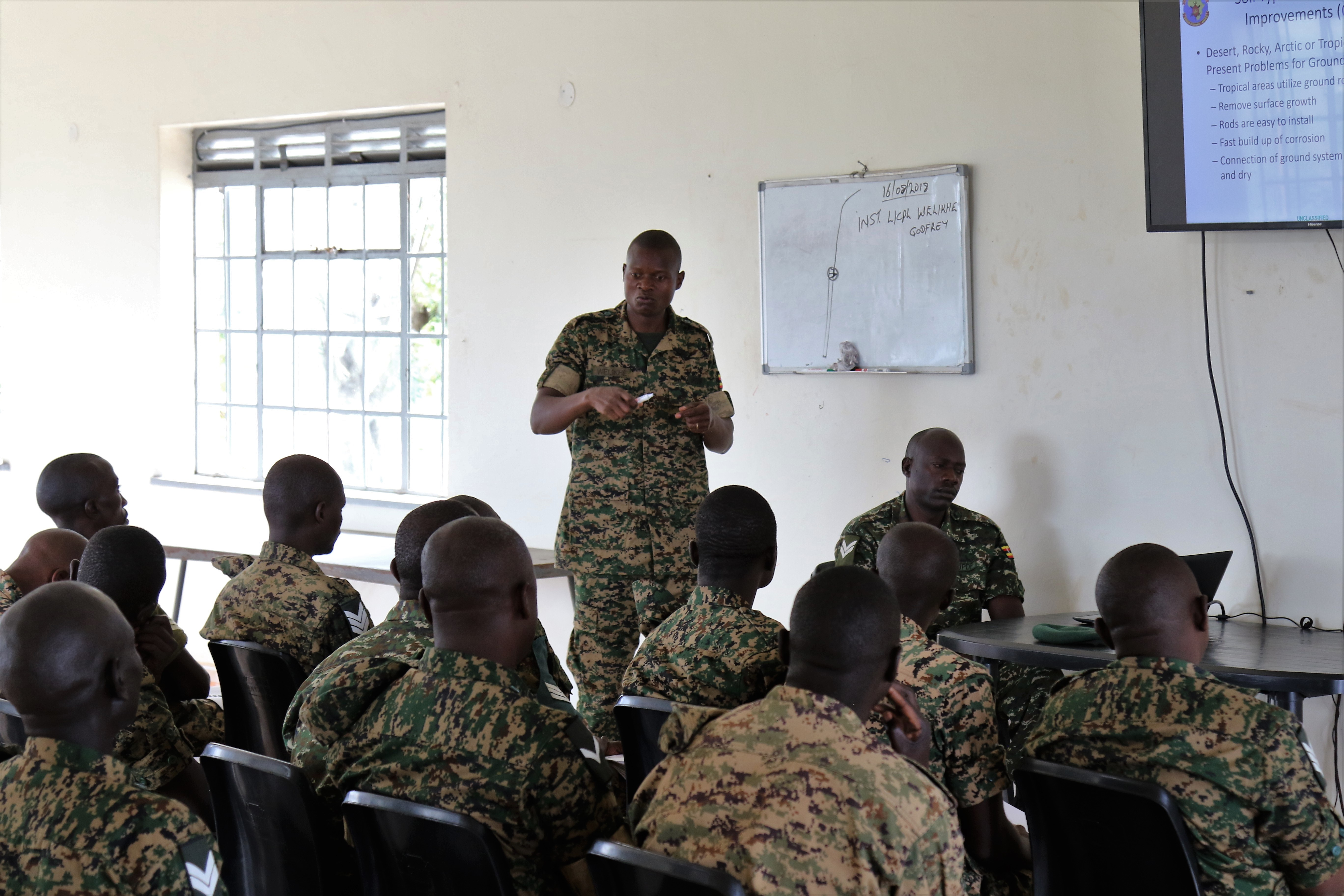 "A Uganda Peoples' Defence Force soldier instructs a logistics training class in Jinga, Uganda Aug. 16, 2018. U.S. Marines conducted the ""train-the-trainer"" course, which allows Ugandan soldiers the skills to teach the course to other UPDF personnel."