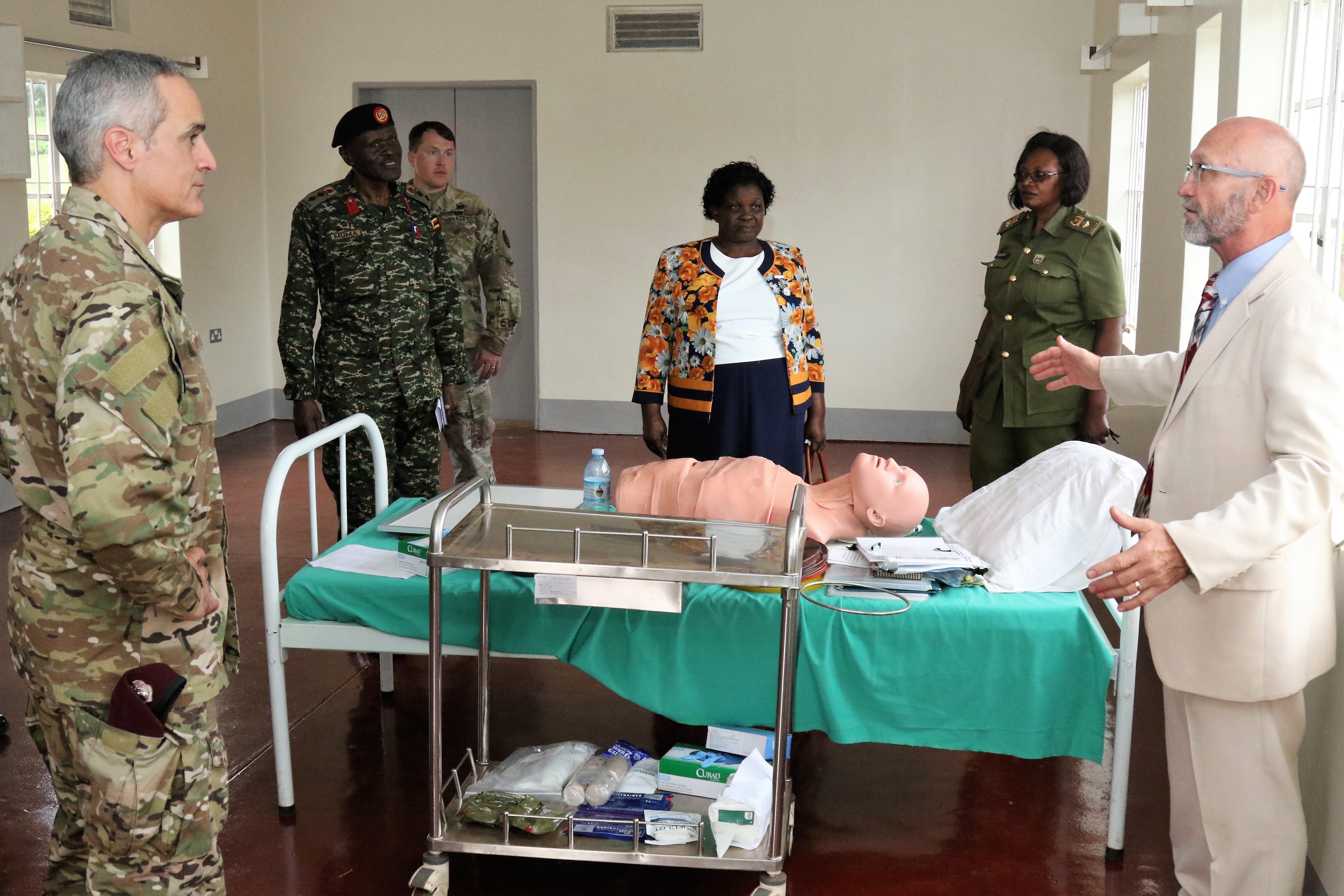 Dr. Charles Beadling, associate professor of military and emergency medicine at the Uniformed Services University of the Health Sciences, explains the uses of the newly renovated skills training lab Aug. 16, 2018 in Jinga, Uganda. The lab was recently renovated and allows Uganda Peoples' Defence Force soldiers to practice essential trauma nursing skills in a simulated environment.