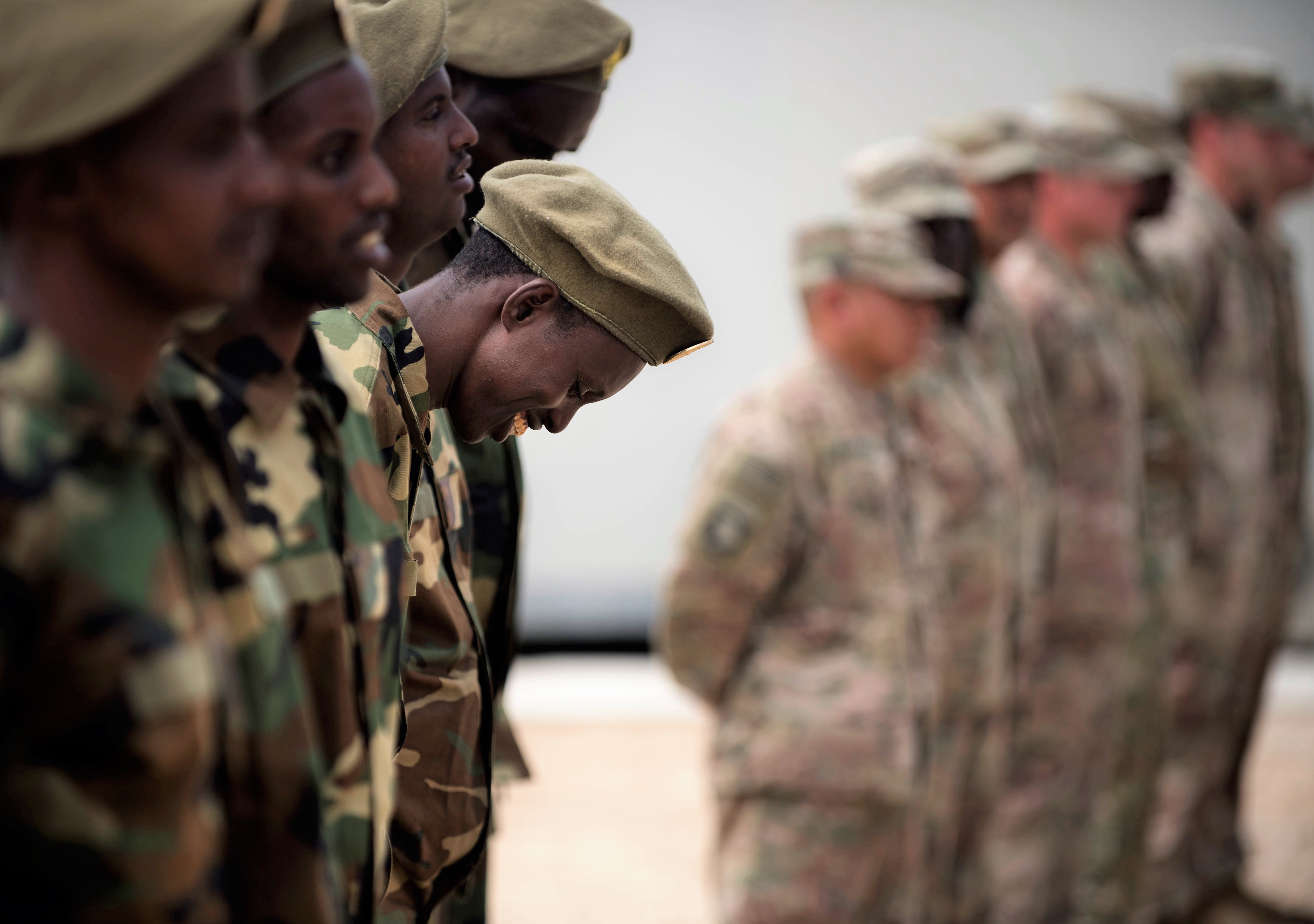 A Somali national army soldier stands in formation awaiting to receive his certificate of completion at a logistics course graduation ceremony.   Soldiers from Somali's special forces DANAB battalion spent 14 weeks training with the U.S. 10th Mountain division on the importance of logistical operation as well as the operation and maintenance of heavy equipment.  (Photo by MC2 (SW/AW) Evan Parker. Released)
