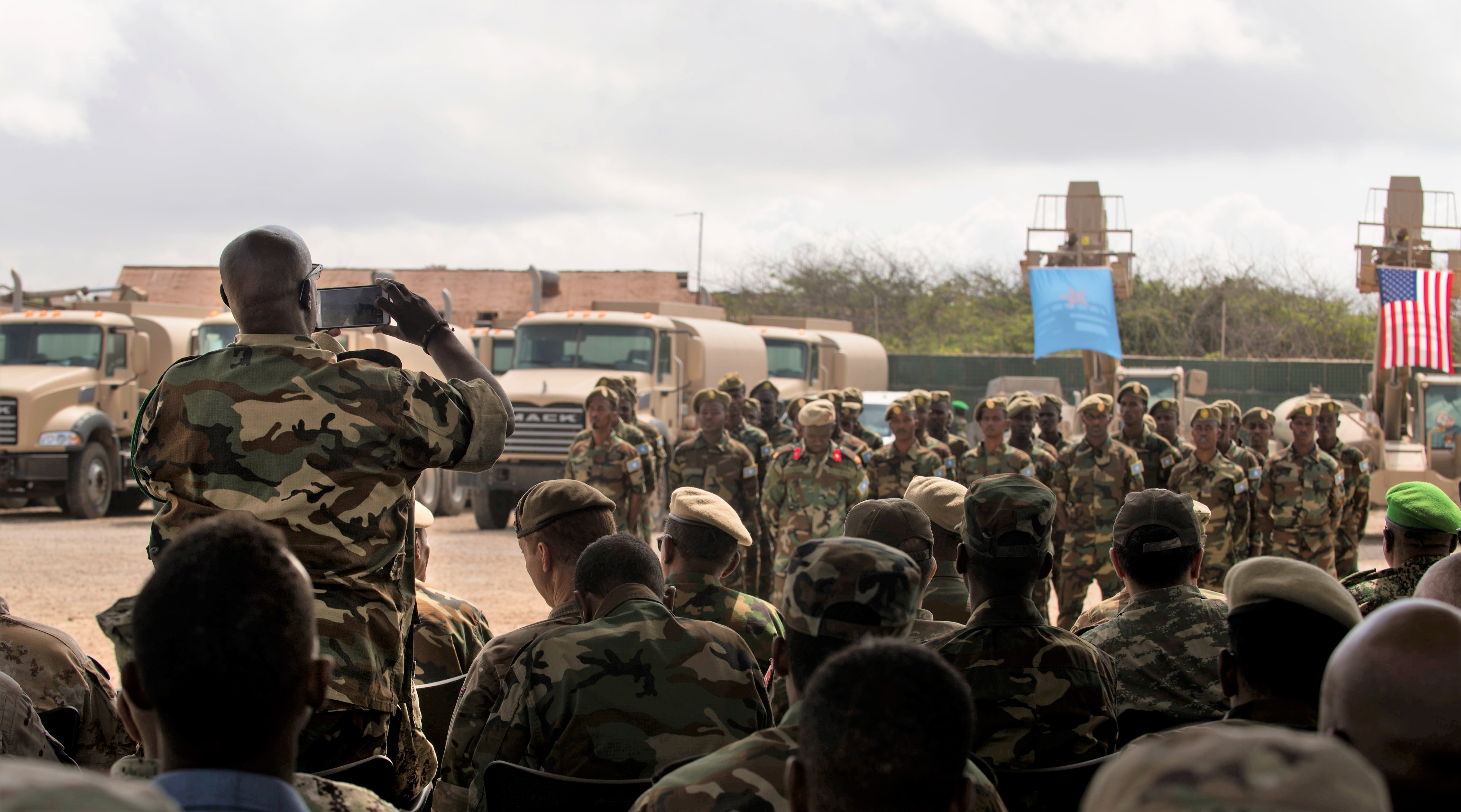 A distinguished visitor snaps a photo of the graduating class during a logistics course graduation ceremony.   Soldiers from Somali's special forces DANAB battalion spent 14 weeks training with the U.S. 10th Mountain division on the importance of logistical operation as well as the operation and maintenance of heavy equipment.  (Photo by MC2 (SW/AW) Evan Parker. Released)