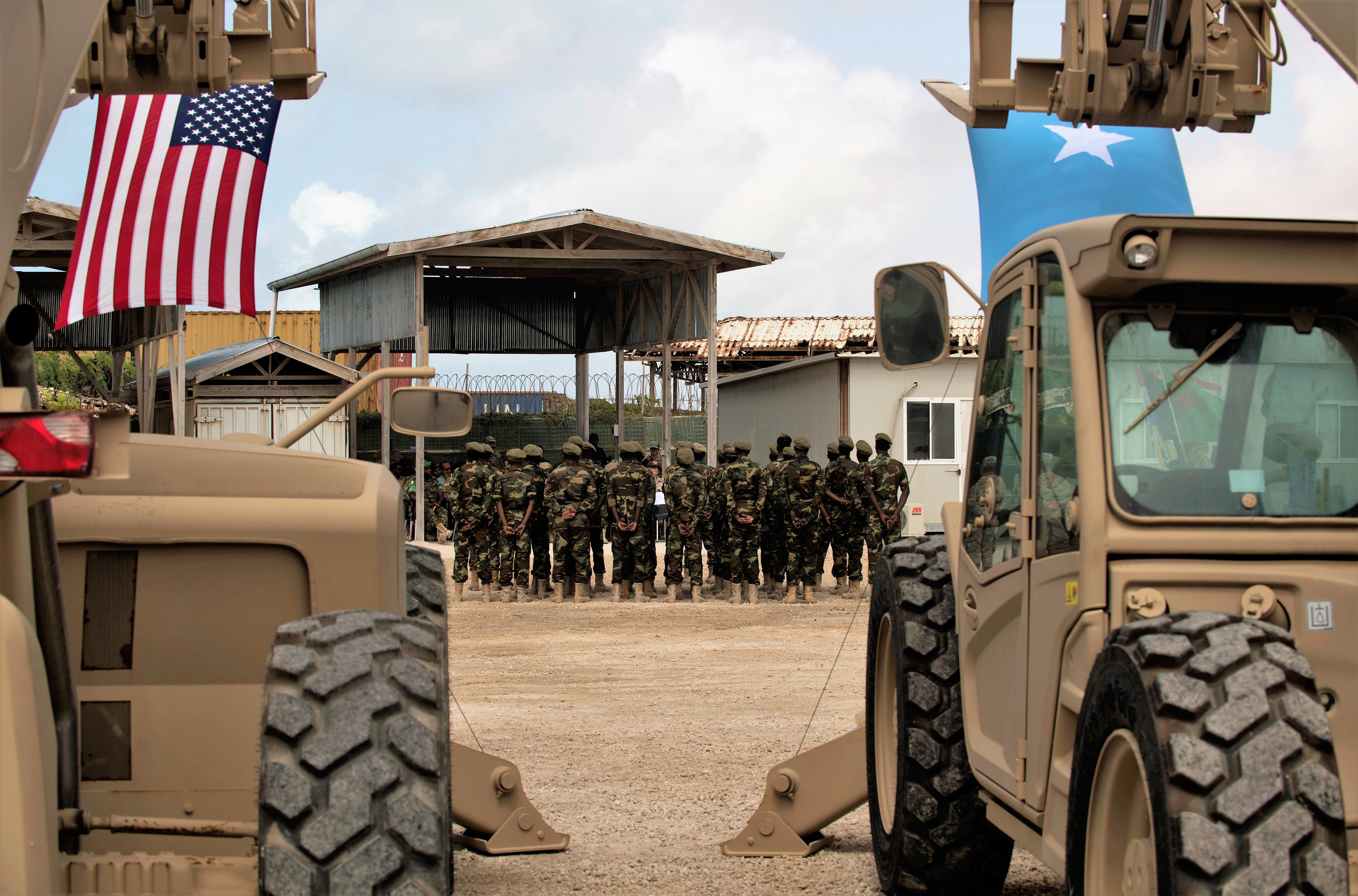 Somali national army soldiers stand in formation during a logistics course graduation ceremony.   Soldiers from Somali's special forces DANAB battalion spent 14 weeks training with the U.S. 10th Mountain division on the importance of logistical operation as well as the operation and maintenance of heavy equipment.  (Photo by MC2 (SW/AW) Evan Parker. Released)