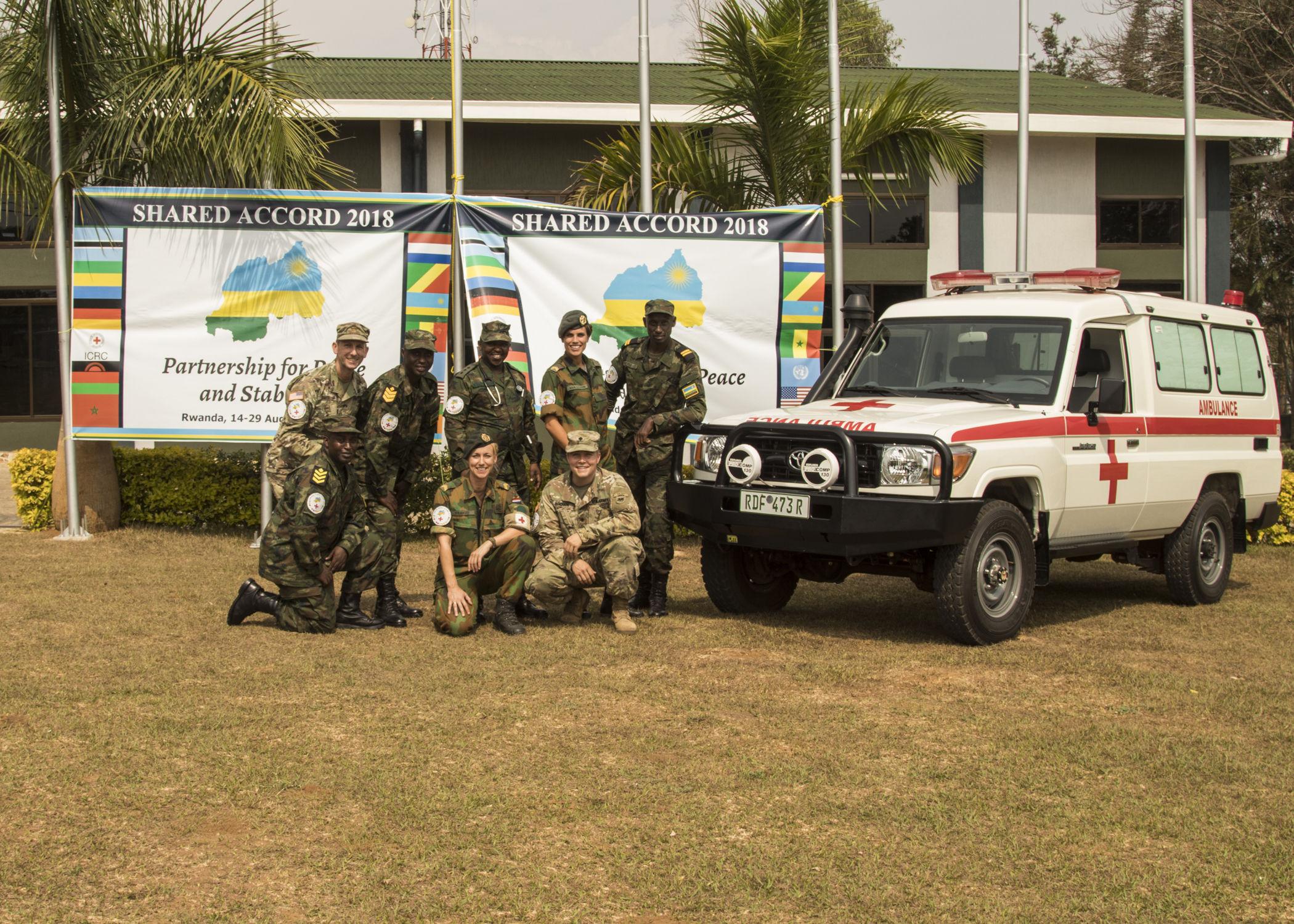 Medical teams from the Rwanda Defence Force, U.S. Army Africa, and the Royal Netherlands Army supporting Shared Accord 2018 pose for a group photo.  Shared Accord is a multilateral exercise intended to enhance U.S. and African forces capabilities to perform peacekeeping operations in support of United Nations and African Union mandates, while shaping the security environment, and deterring violent extremist organizations.  (U.S. Army photo by Sgt. Jennifer Garza, U.S. Army Africa/RELEASED)