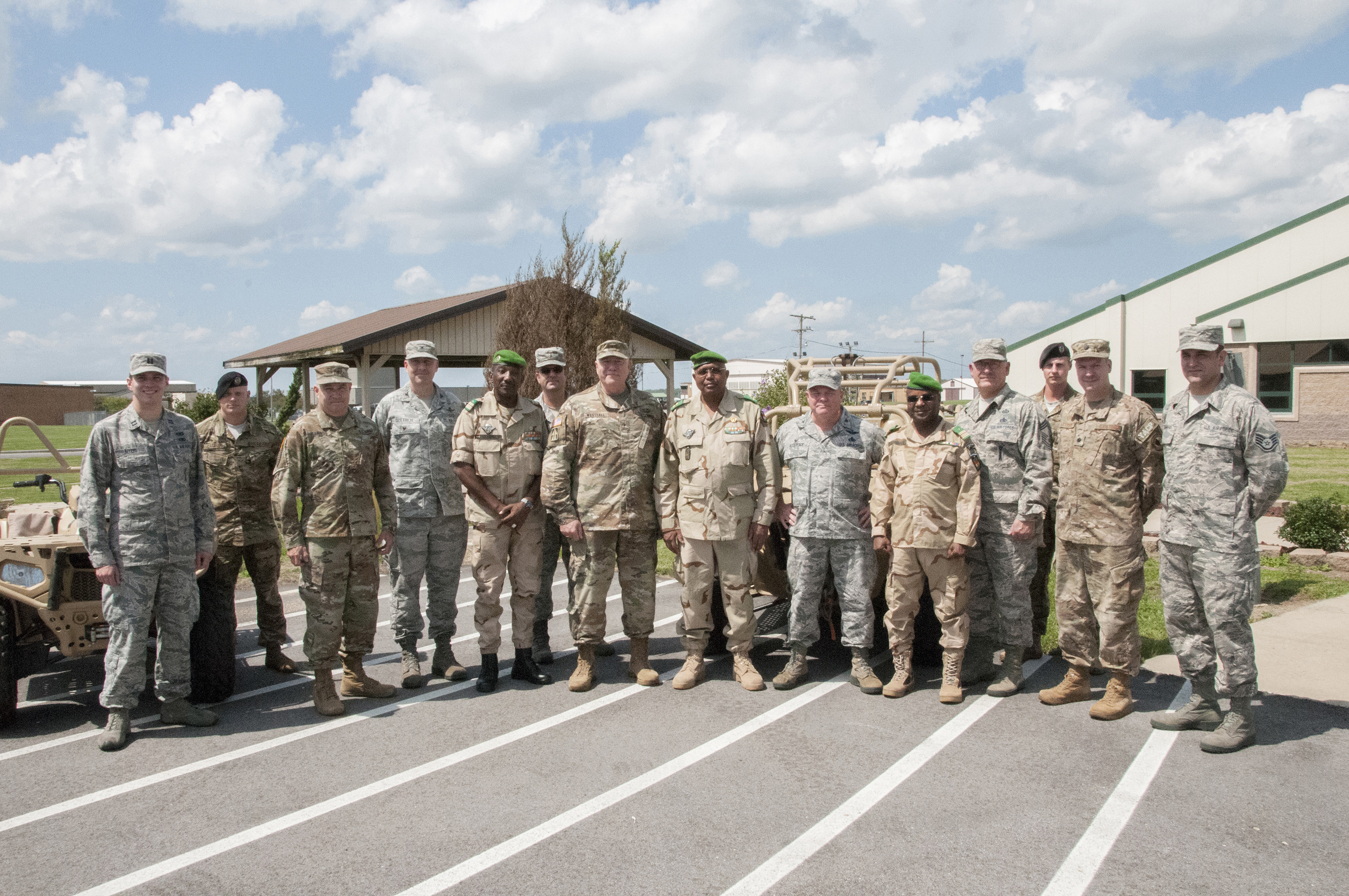 Service members from the Niger Armed Forces and Indiana National Guard pose for a group photo at the conclusion of a State Partnership Program meeting at Hulman Field Air National Guard Base, Terre Haute, Indiana, Aug. 28, 2018. The National Guard State Partnership Program is an innovative Department of Defense joint security cooperation program, administered by the National Guard Bureau, guided by State Department foreign policy goals, and executed by the State Adjutants General in support of Combatant Commander and U.S. Chief of Mission security cooperation objectives and Department of Defense policy goals. (U.S. Air National Guard photo by Staff Sgt. Lonnie Wiram)