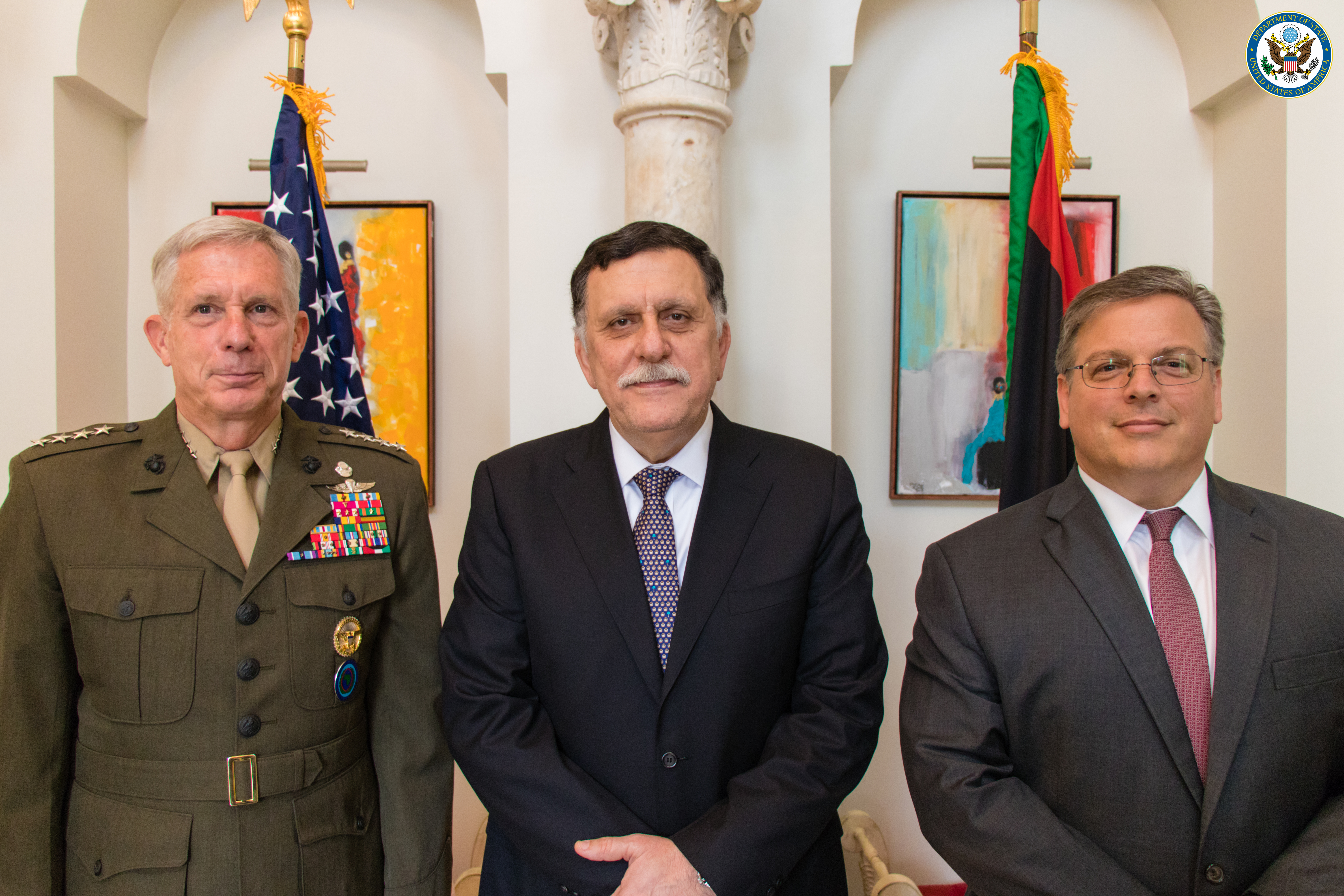 From Left to right: U.S. Marine Corps Gen. Thomas Waldhauser, commander, Libyan Prime Minister Fayez al-Sarraj, and Chargé d'Affaires of the U.S. Department of State's Libya External Office Donald Blome.