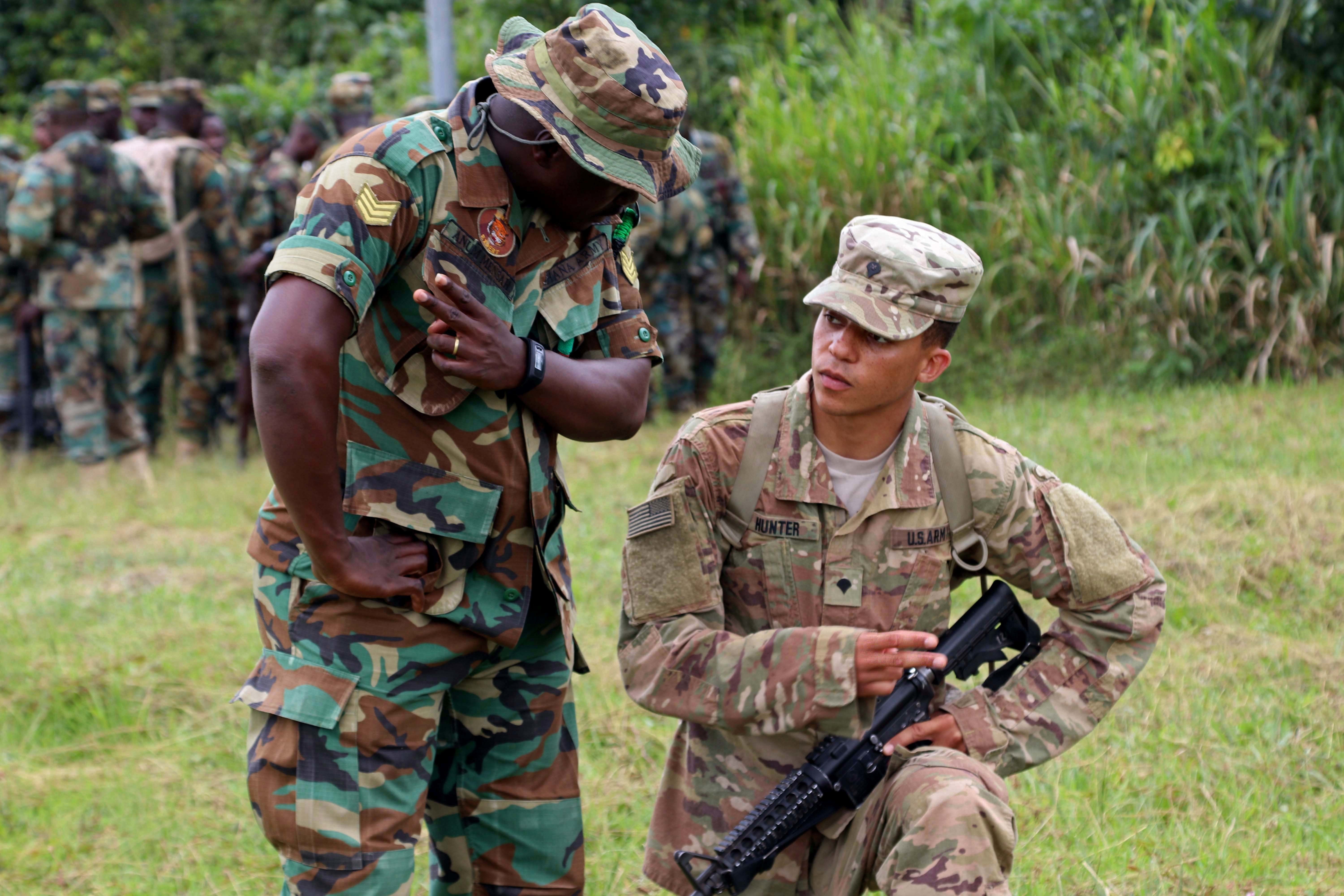 U.S. Army Soldiers receive training on jungle movements and signals at Jungle Warfare School, Achiase Military Base, Akim Achiase, Ghana, August 1, 2018. The Jungle Warfare School is a series of situational training exercises designed to train participants in counter-insurgency and internal security operations. (U.S. Army photo by Staff Sgt. Charles Stefan)
